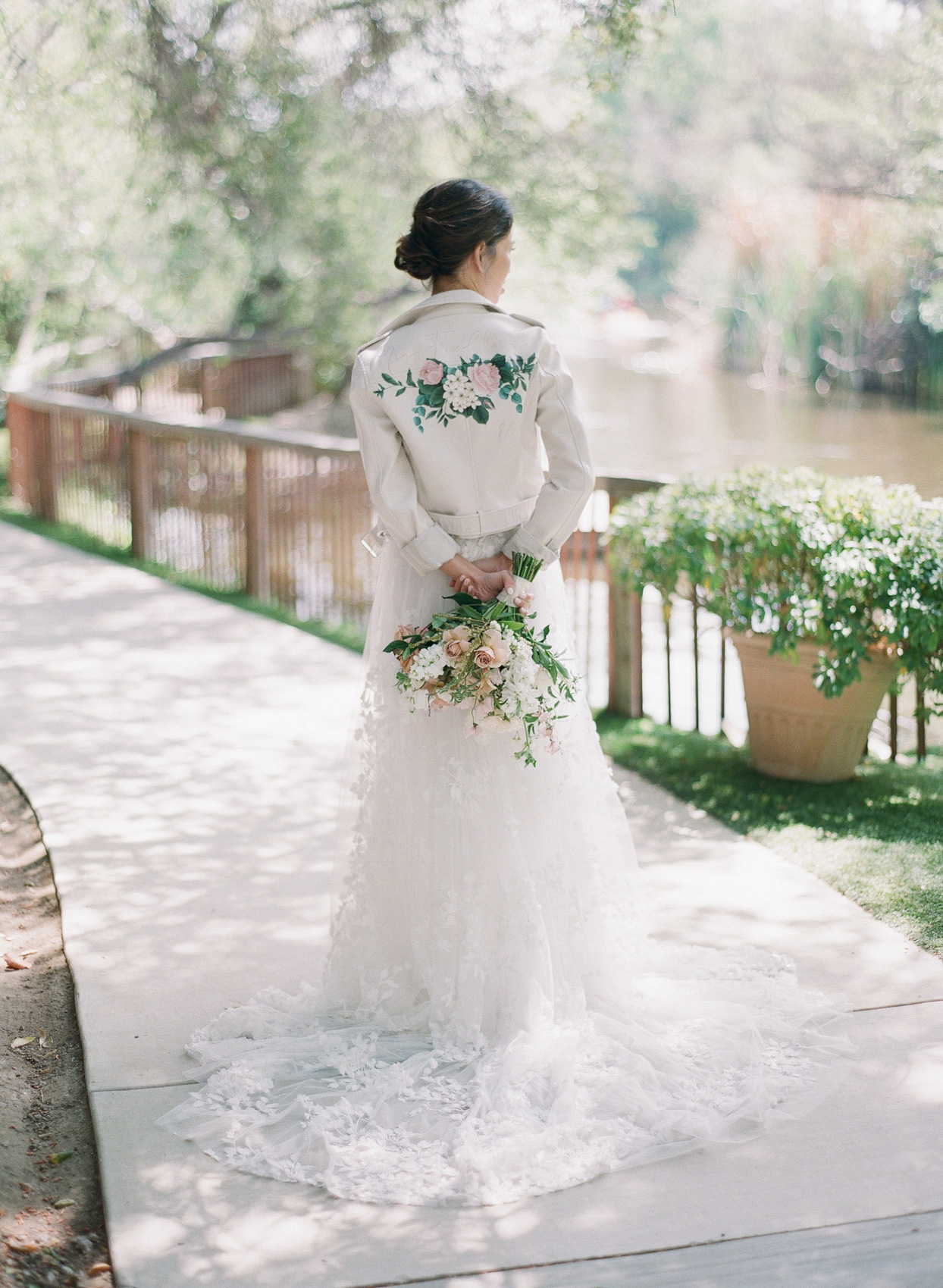 bride in wedding dress with white leather jacket
