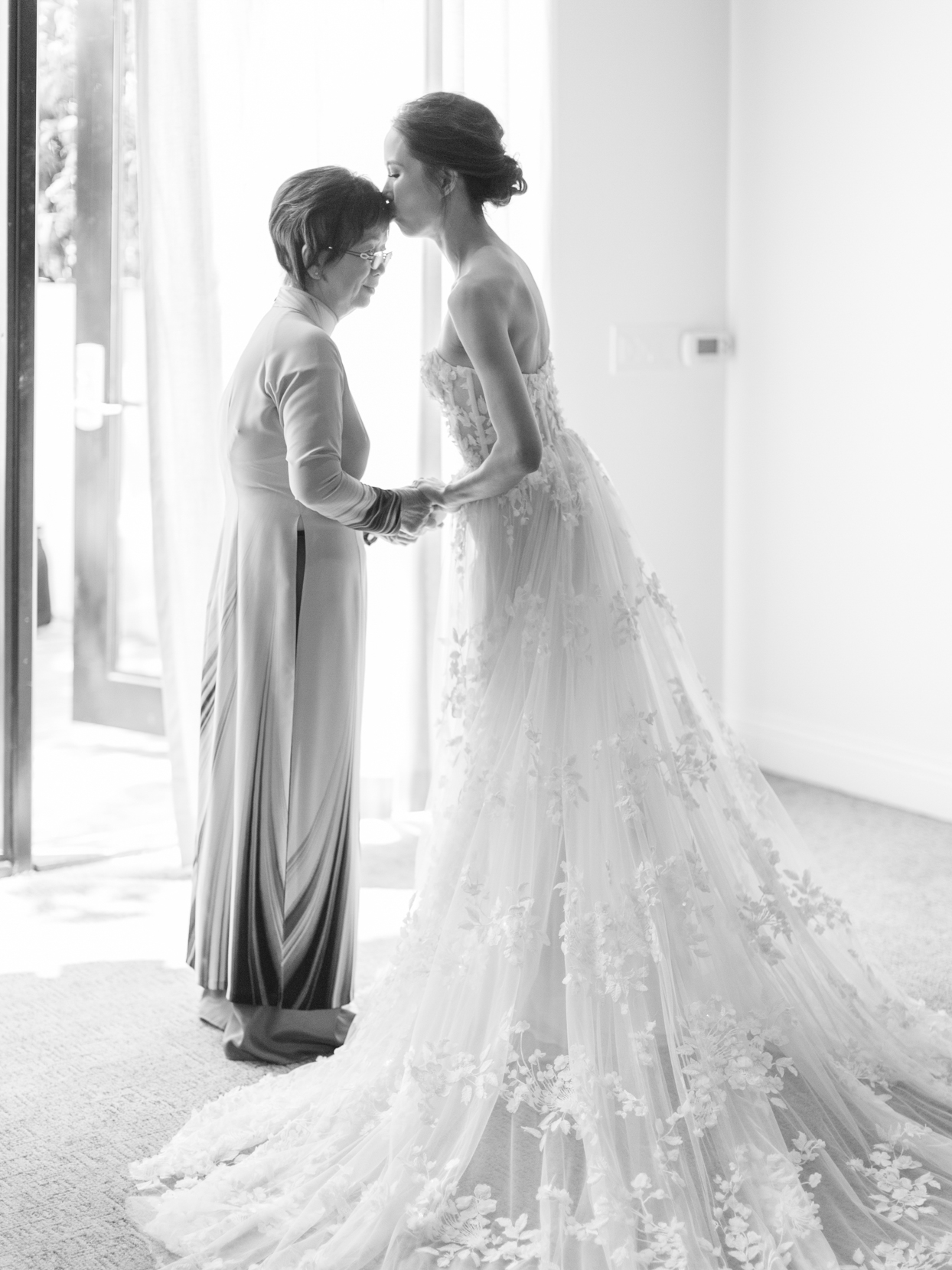 bride in dress with mother