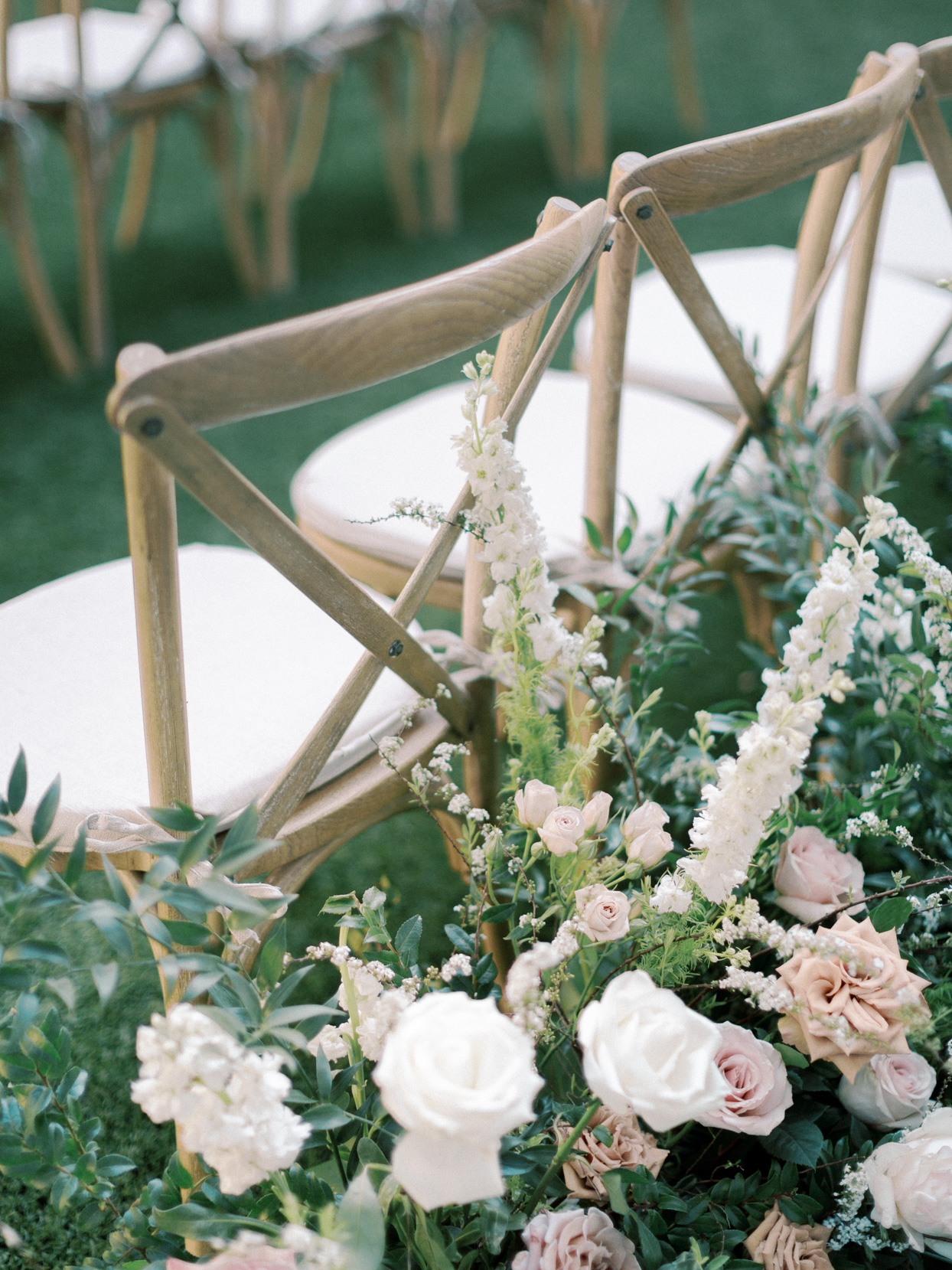 ceremony seating with aisle floral arrangements