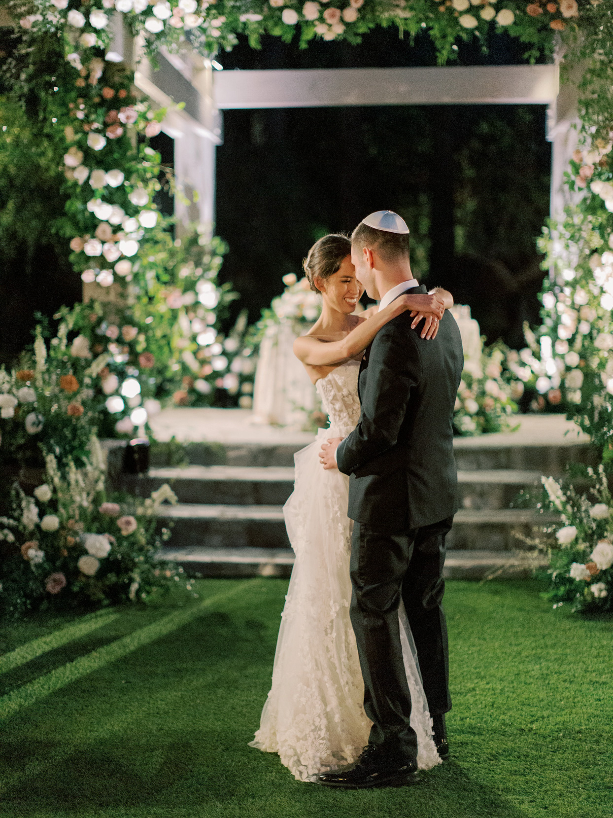 bride and groom share first dance in the grass
