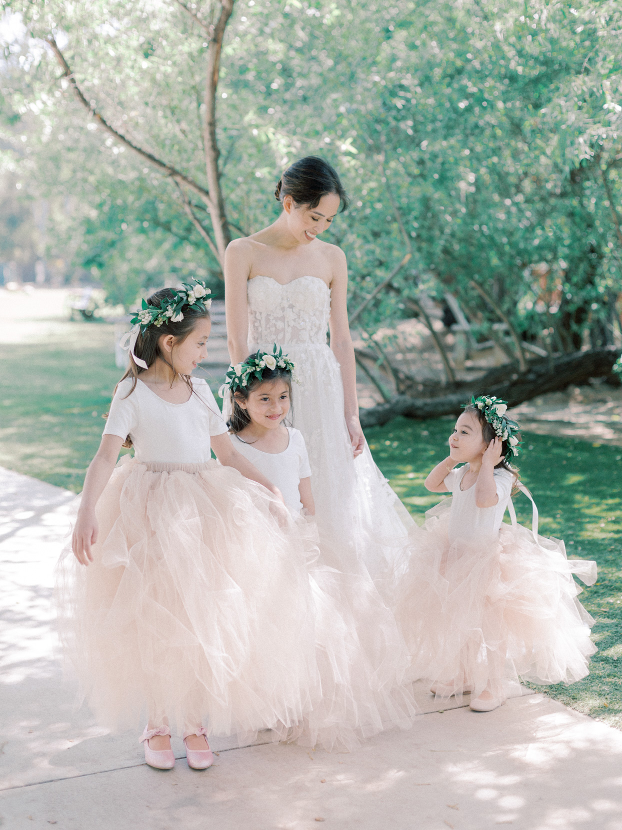 bride with three flower girls in pink dresses