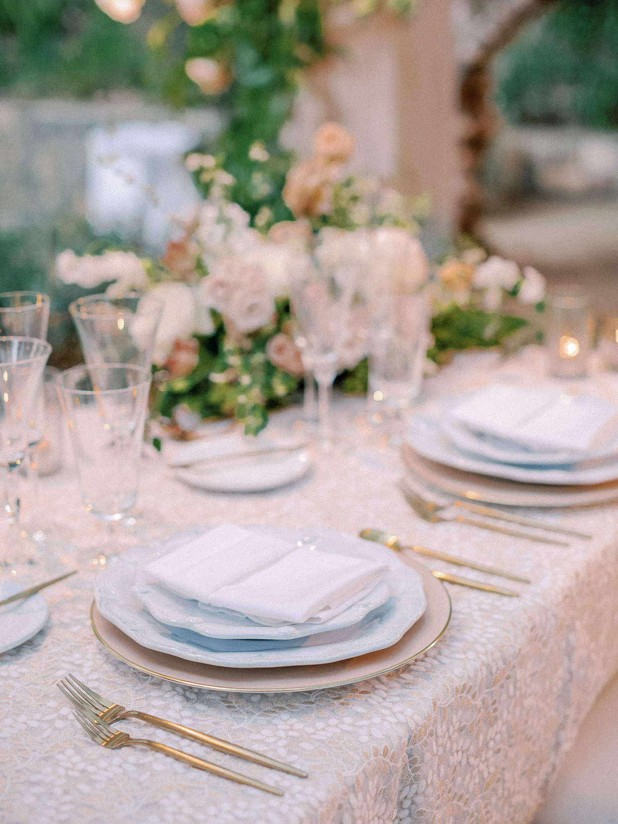 table setting with pink china and gold utensils