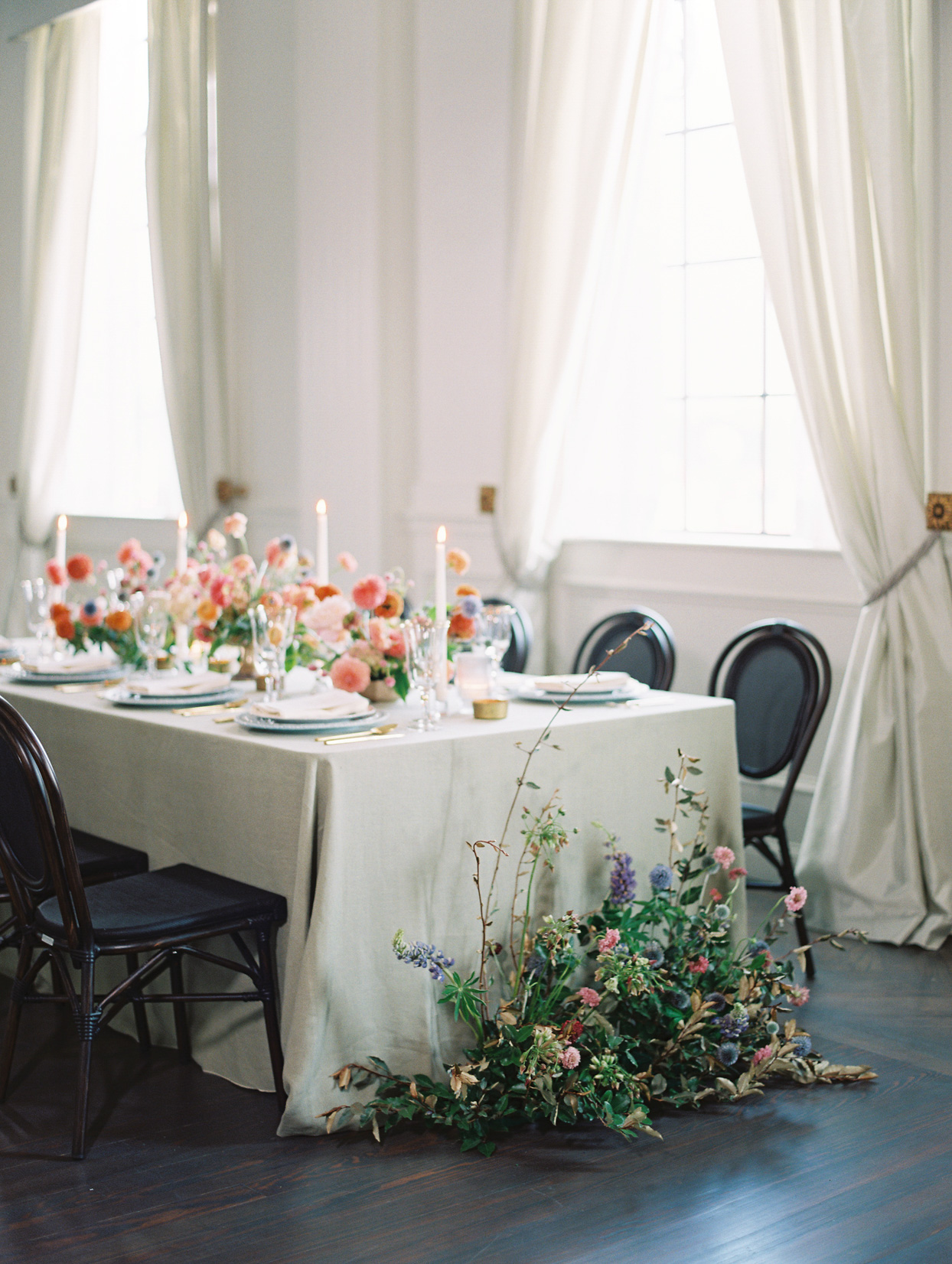 reception table with floral arrangements and candles