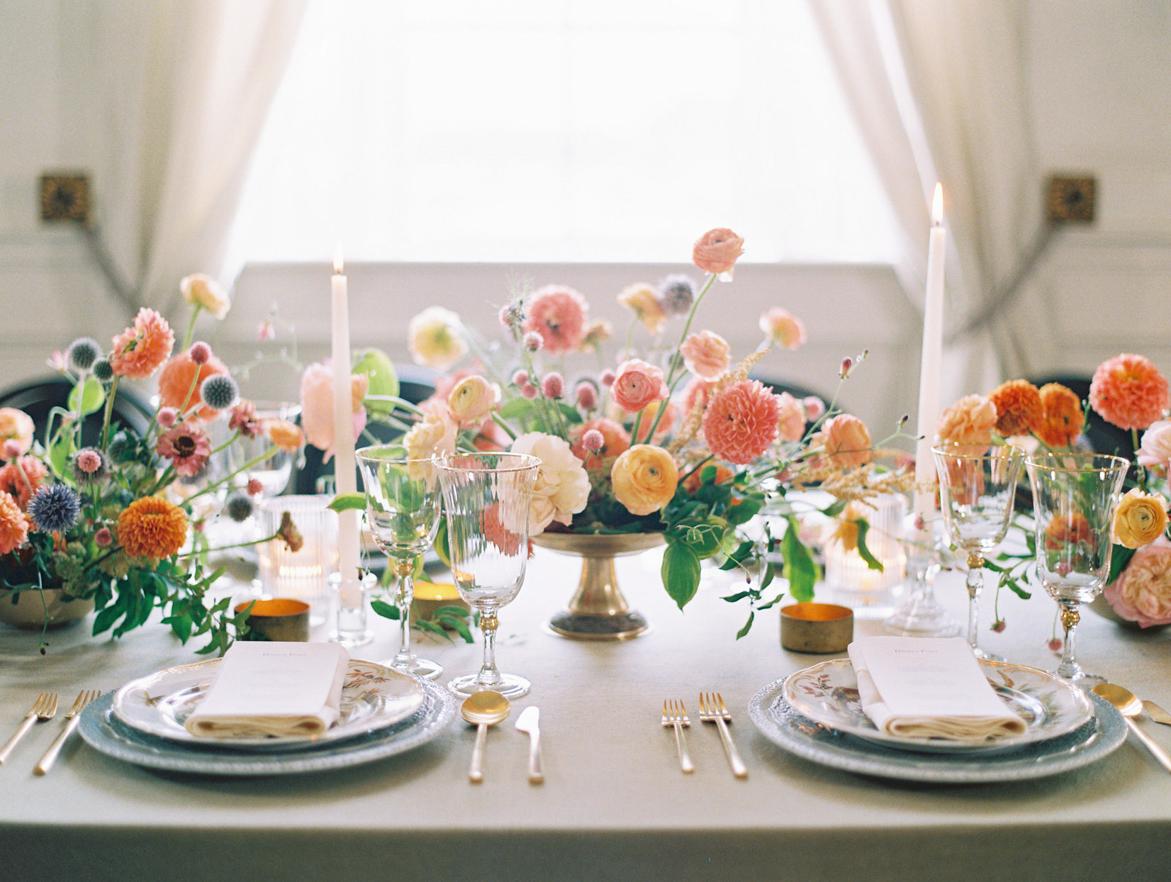 reception table top details with candles and fun floral arrangements