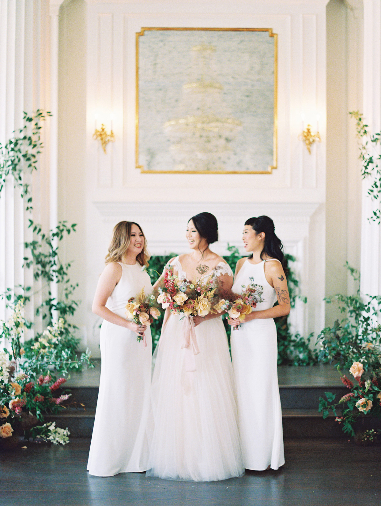 bride with her two sisters in white bridesmaid dresses