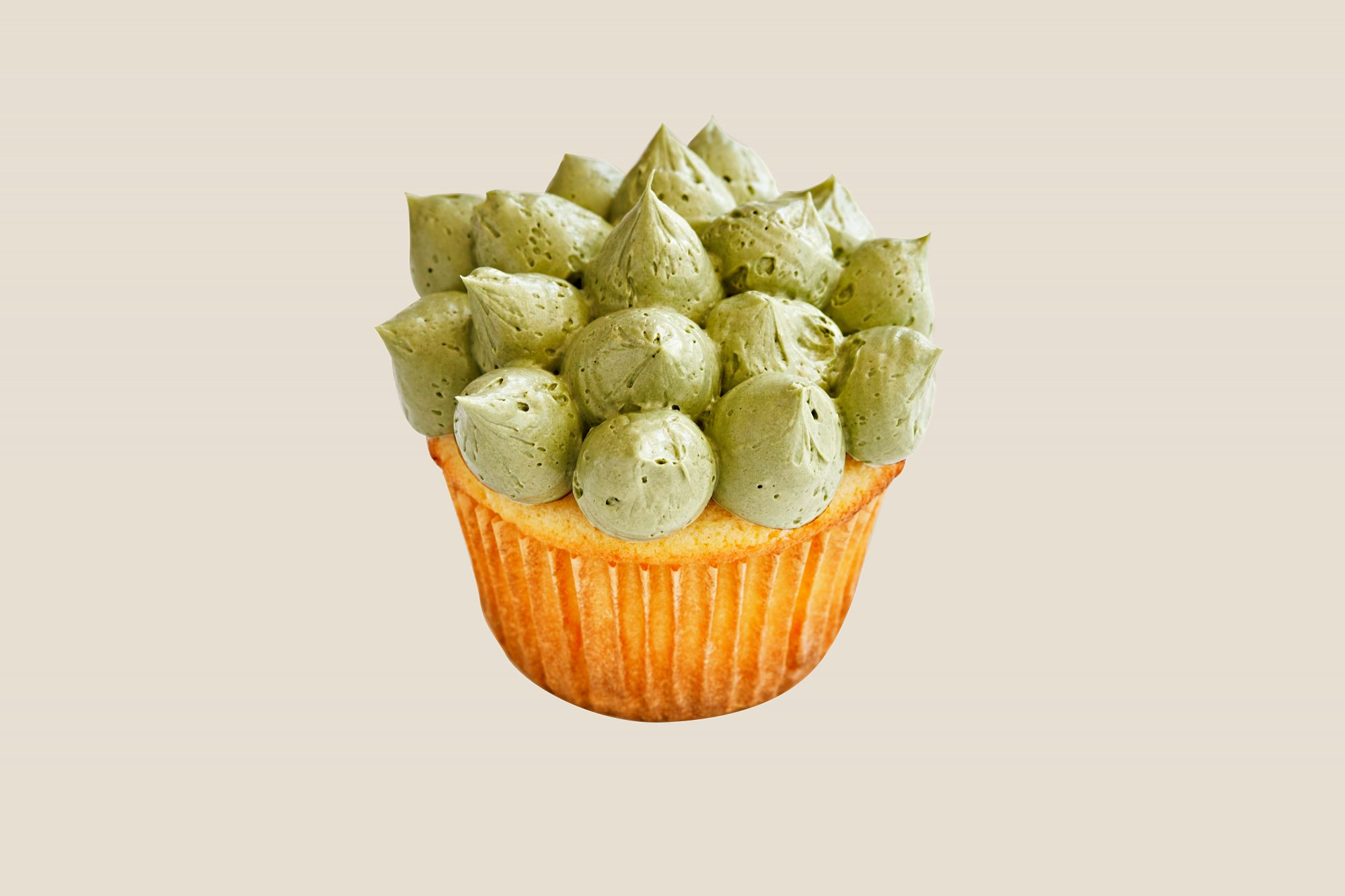green frosting spiky crown piping cupcake