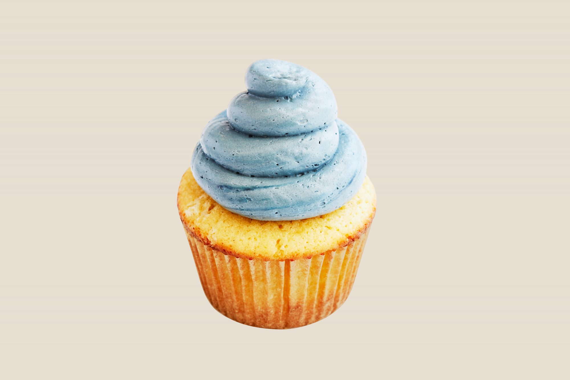 blue frosting piping on cupcake