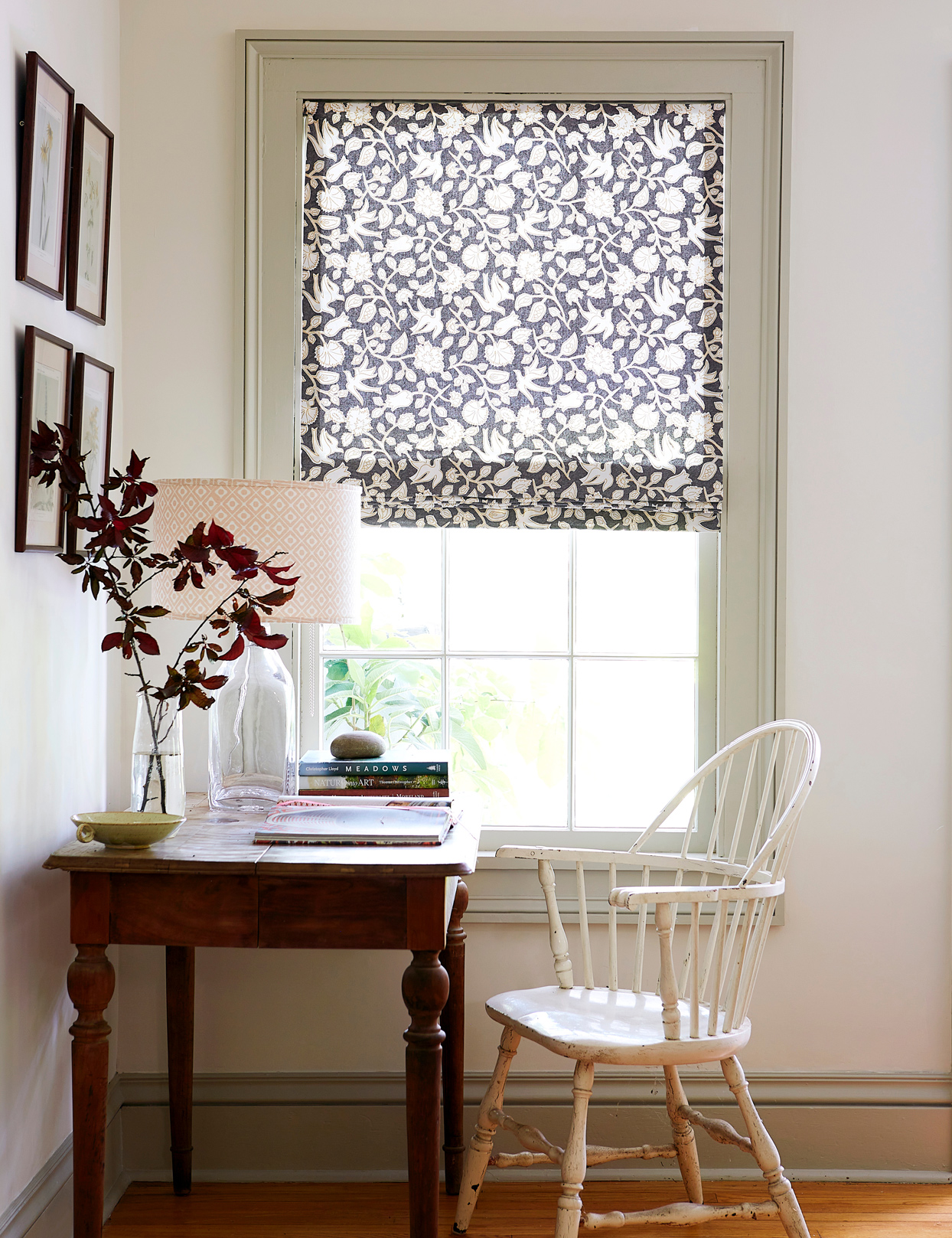 desk near window with floral shades