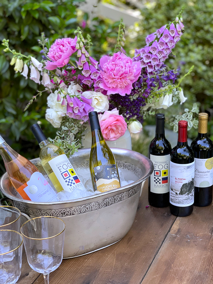 martha stewart wineco selection arranged on table with flowers