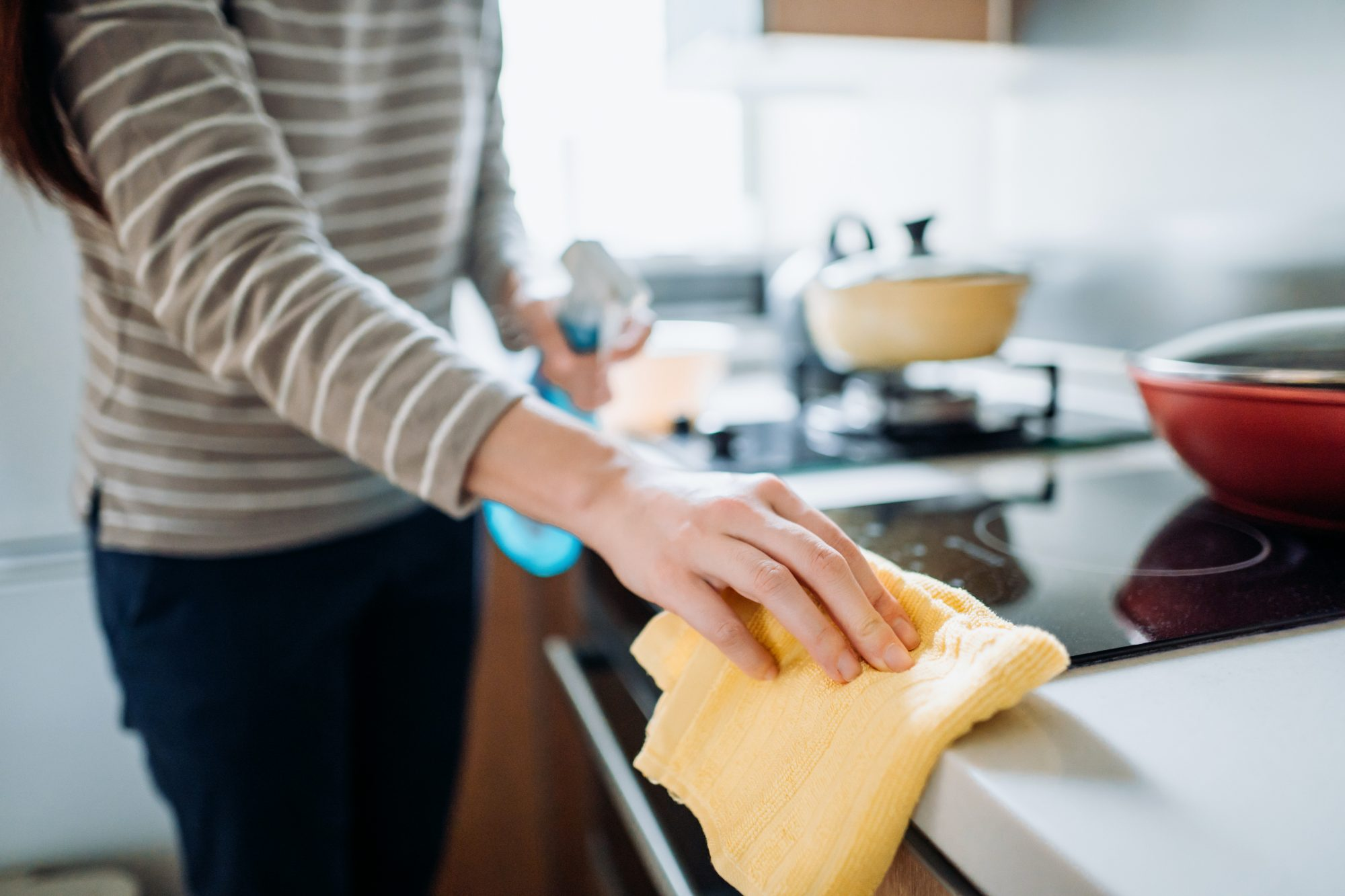 close up of woman cleaning kitchen counter