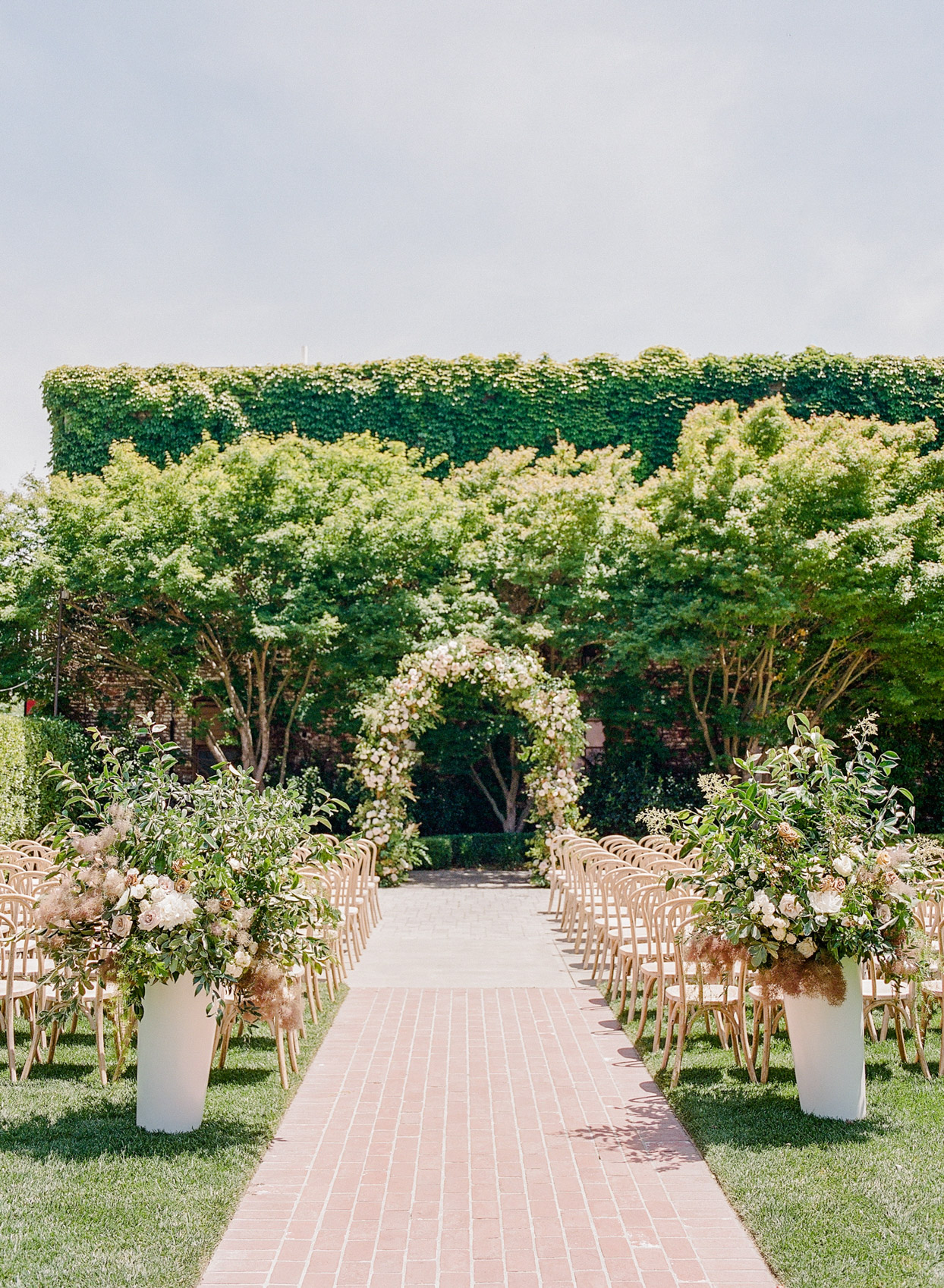 outdoor wedding ceremony set up with chairs and archway