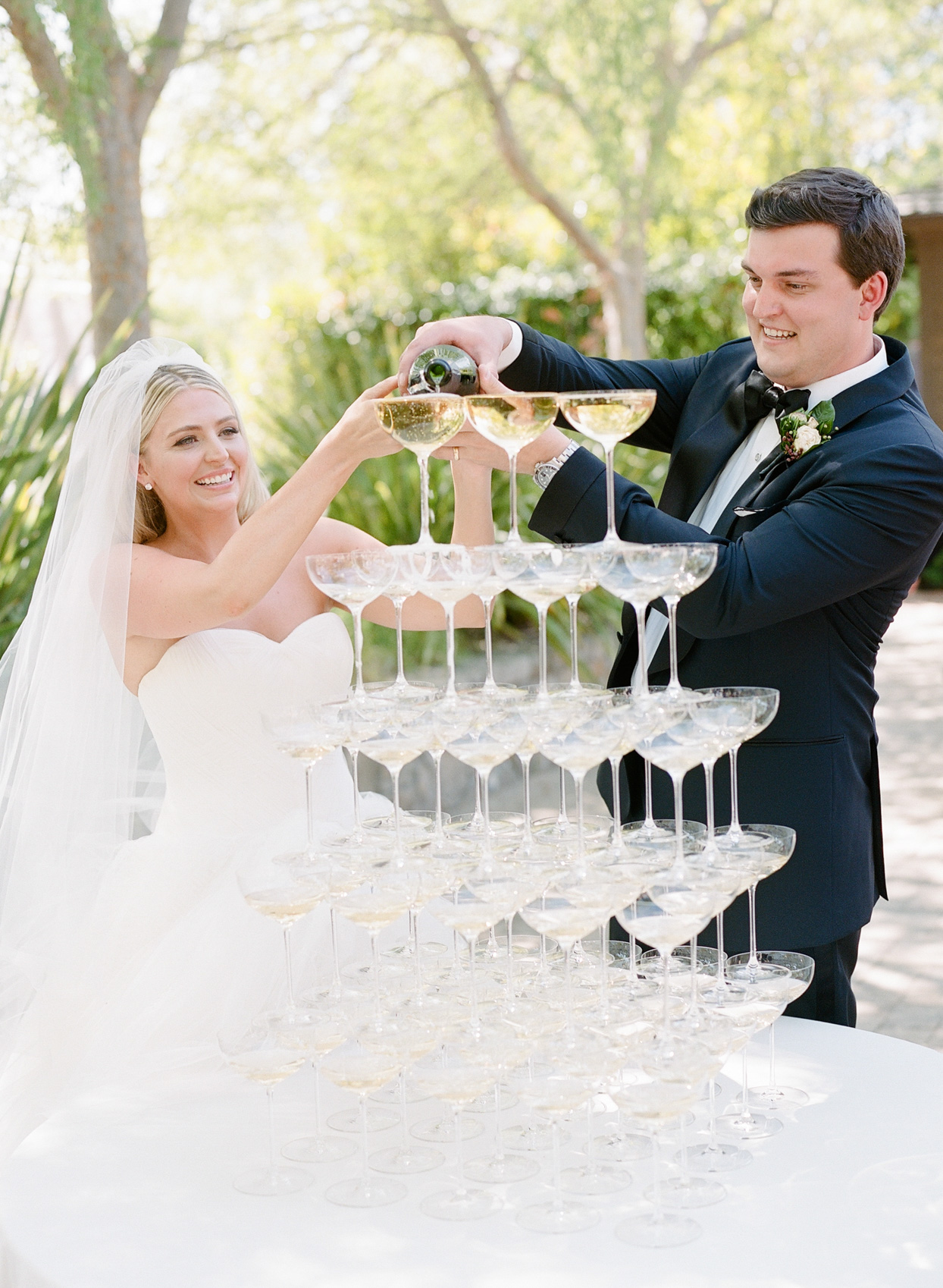 bride and groom pouring champagne tower