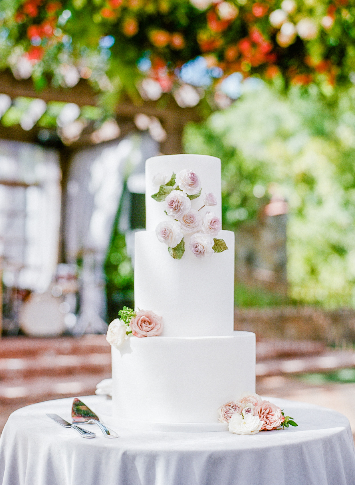 simple three-tiered wedding cake with flower accents