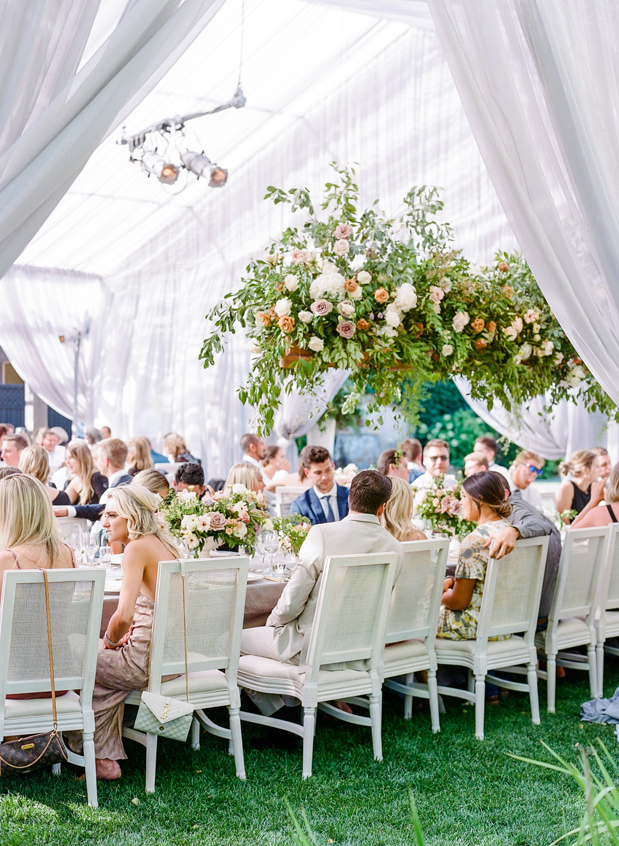 seated guests and long reception tables