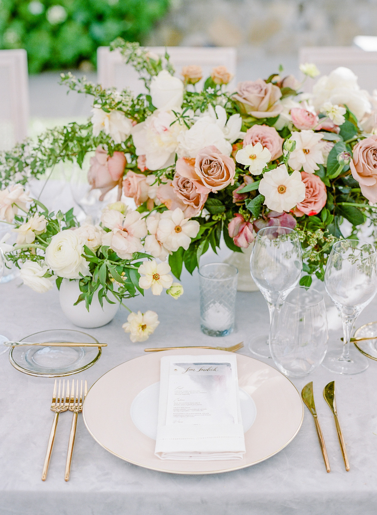 reception table setting with blush pink plate and gold utensils