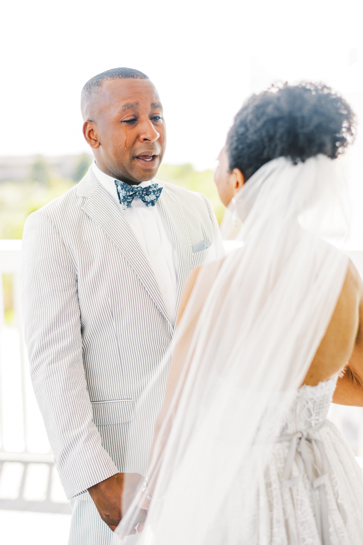 groom crying while looking at bride during first look