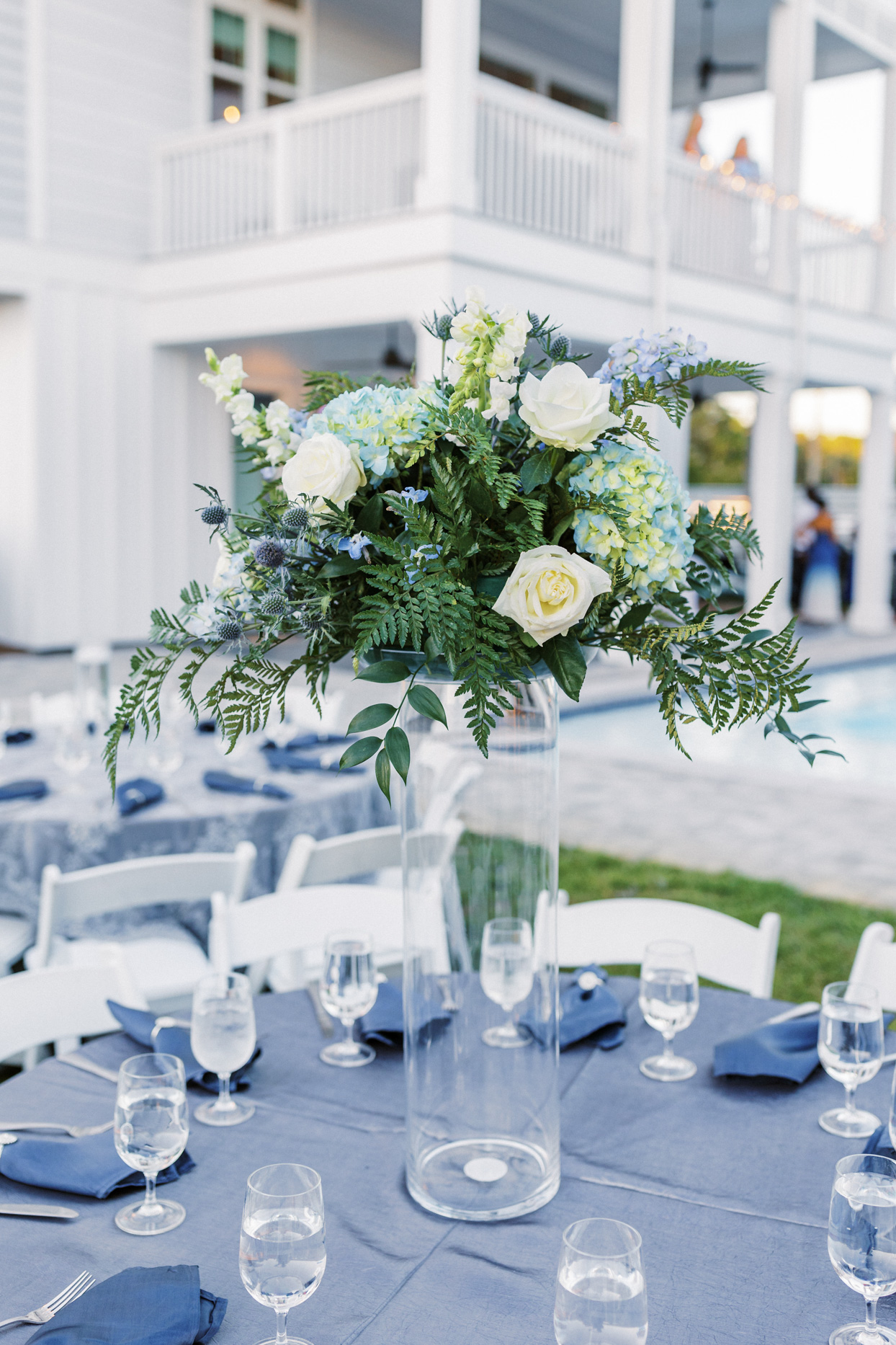 elegant blue and white flowers on wedding reception table