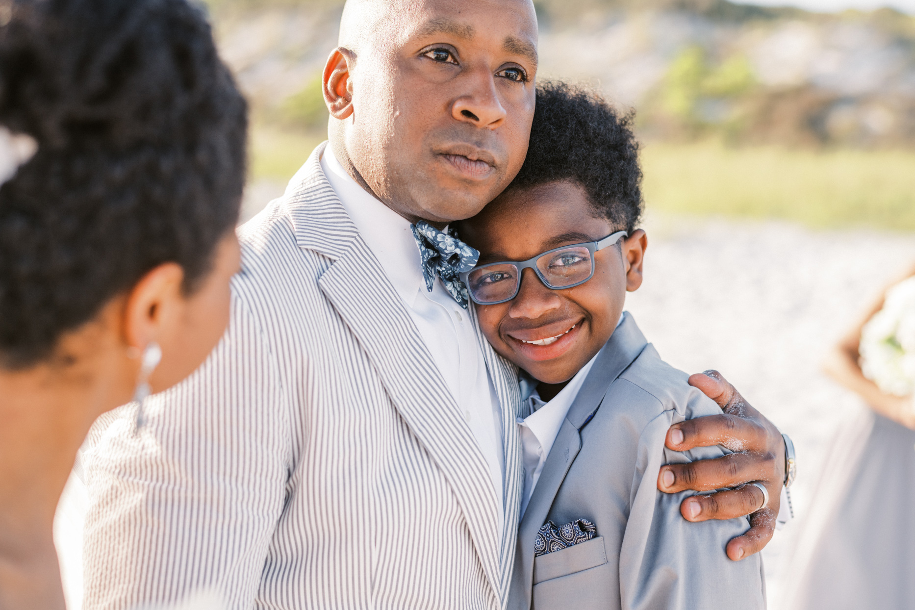 groom and son hugging at wedding ceremony