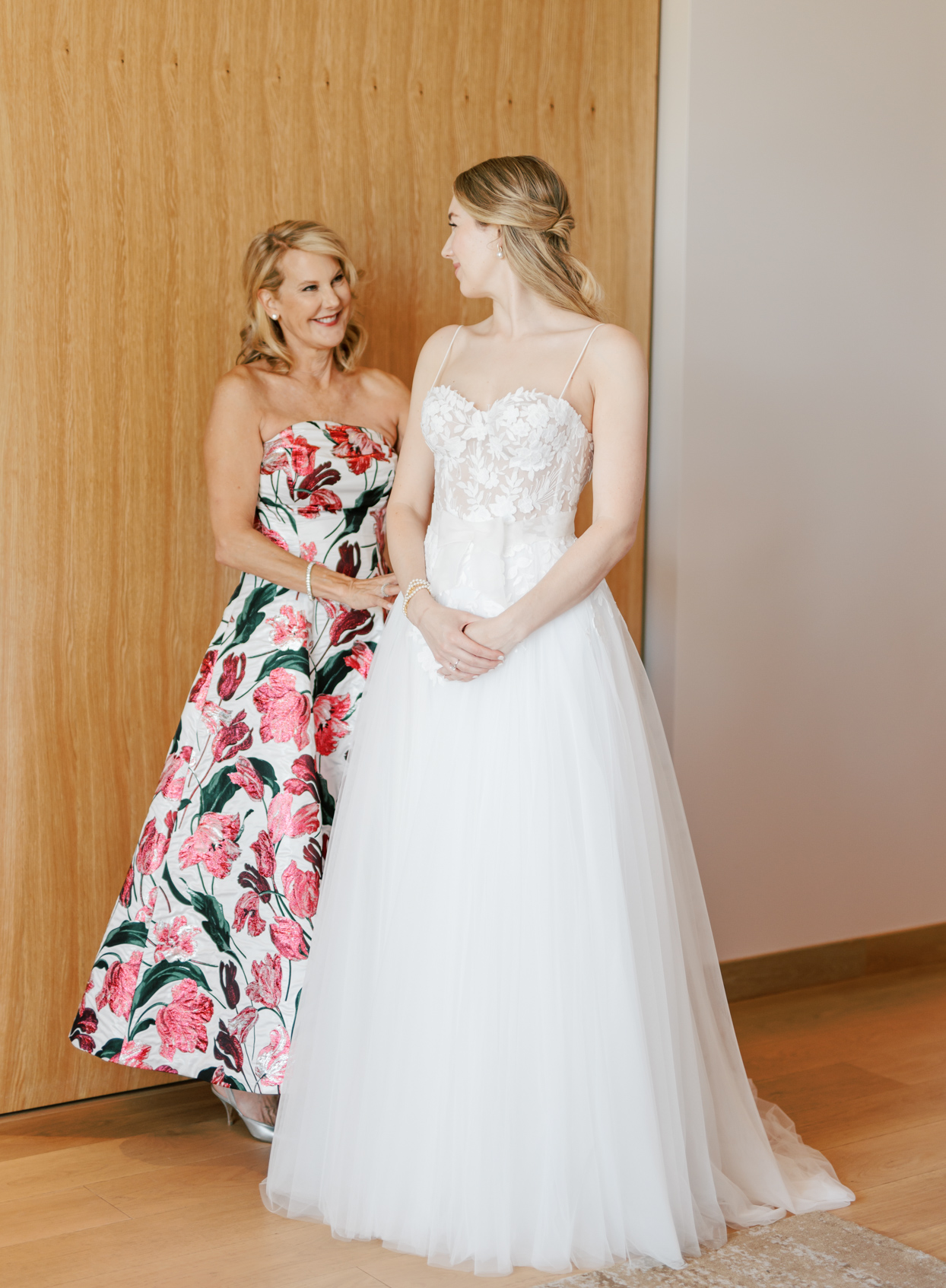 bride and mother in pink floral dress