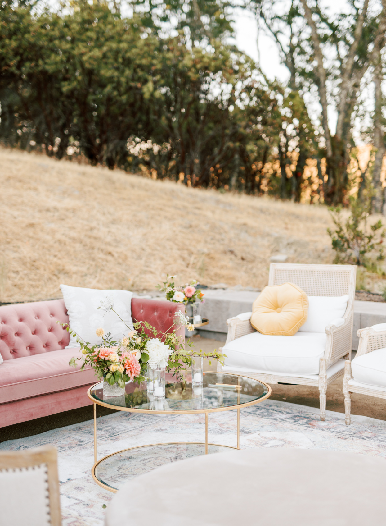 pink and gold outdoor wedding lounge