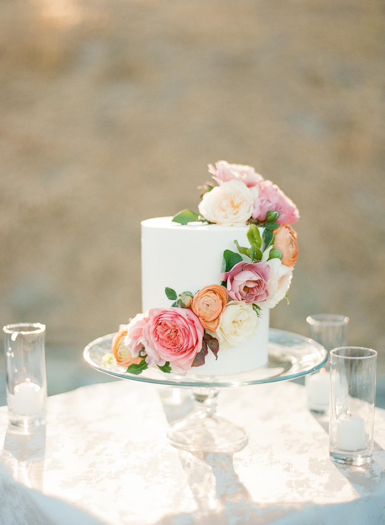 single tier wedding cake with pink and orange flowers