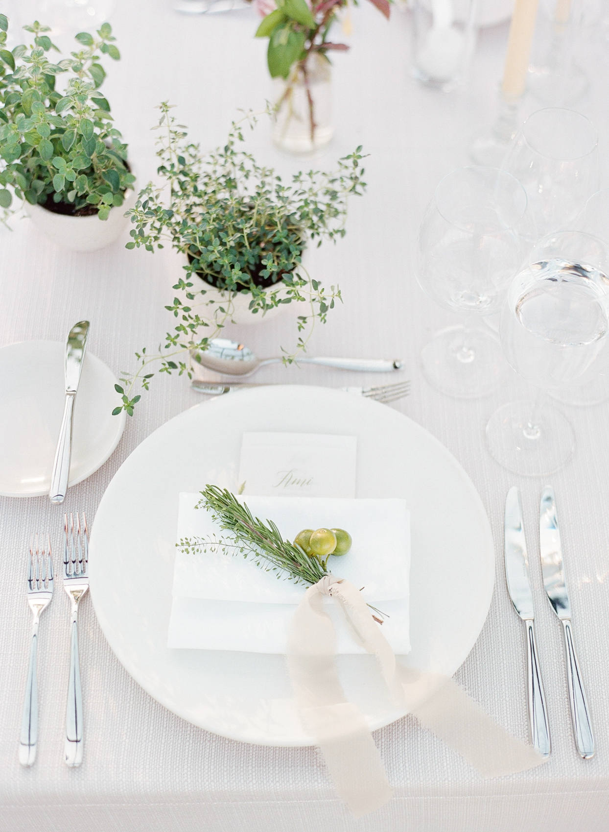 white place setting at wedding reception