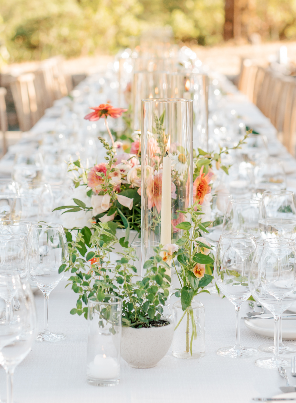 wedding reception long table with flowers and candles