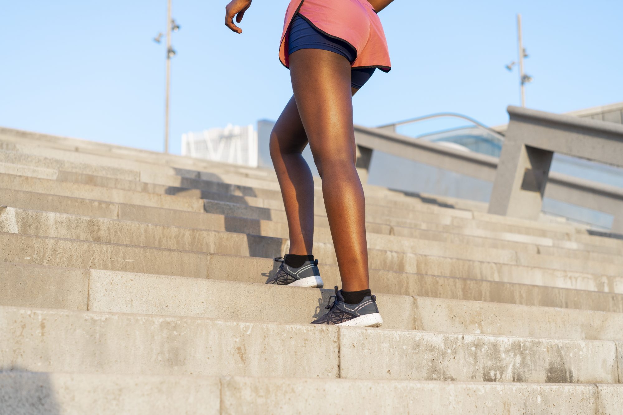 woman exercising walking up stairs outdoors