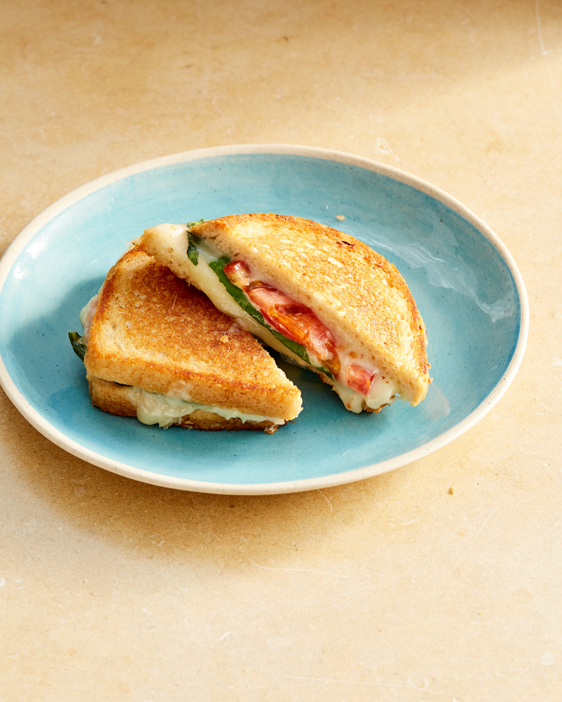 plated grilled cheese with tomato