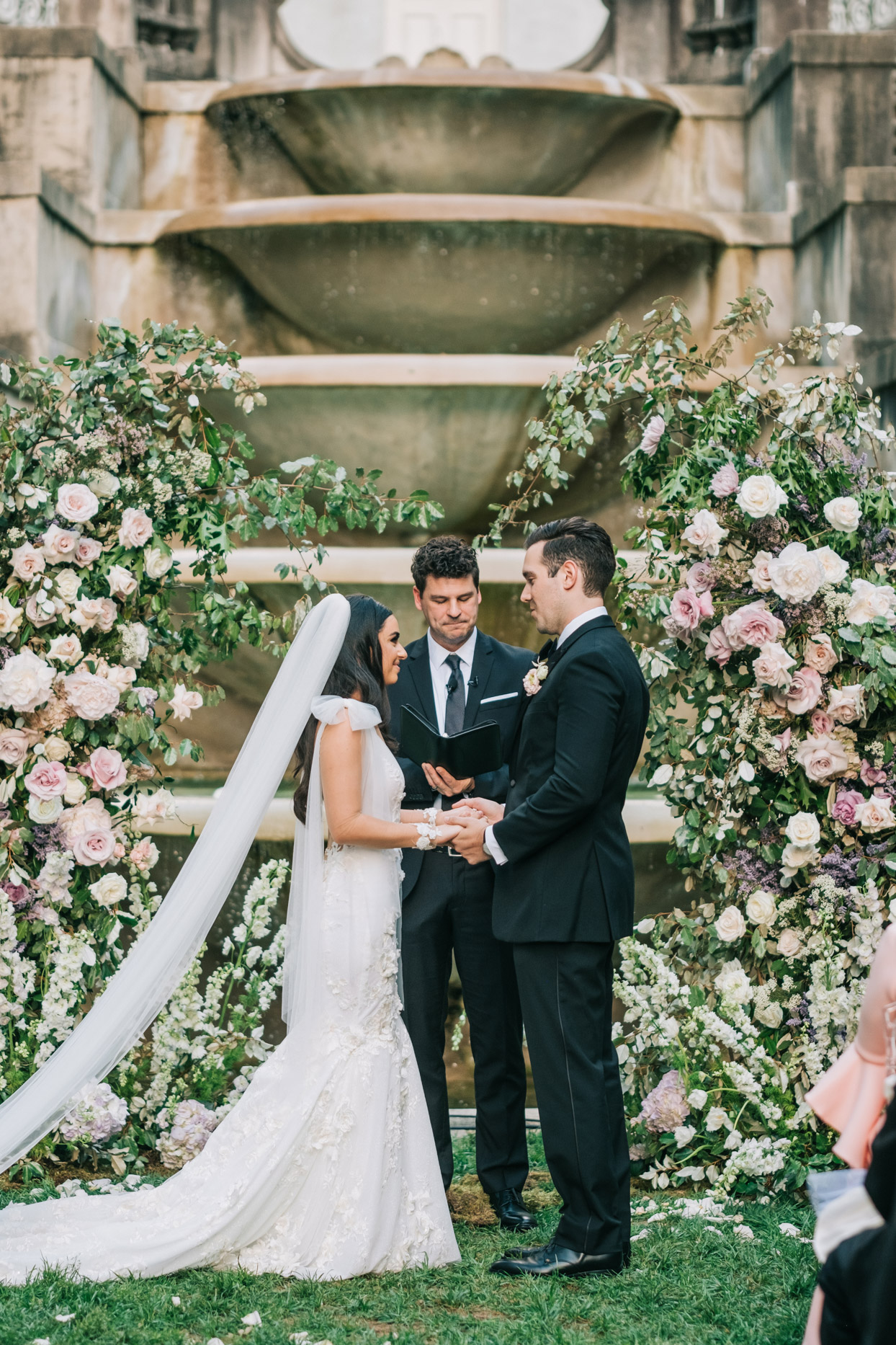 wedding ceremony floral arch comprised of a variety of roses