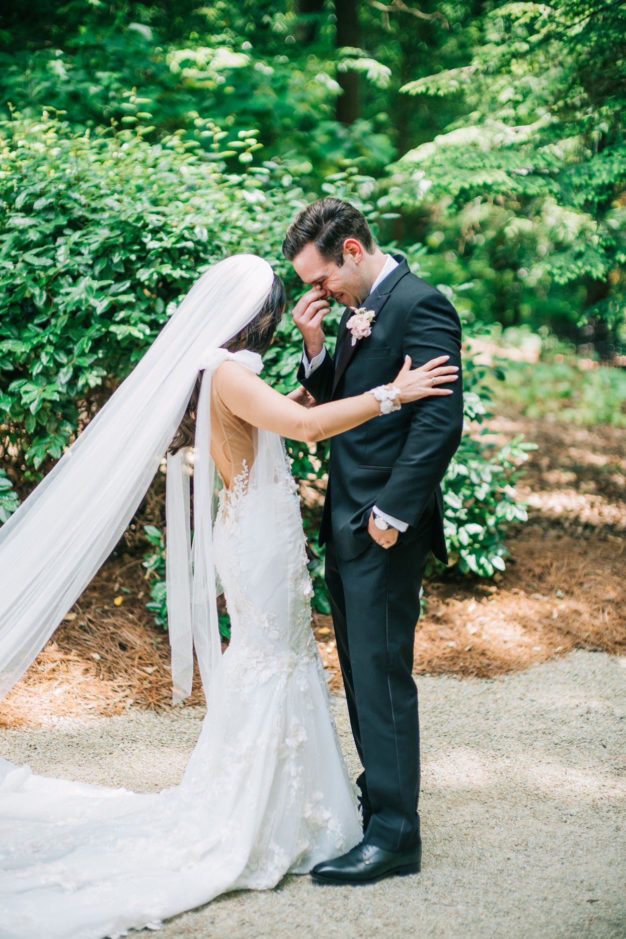 groom crying while sharing first look with bride