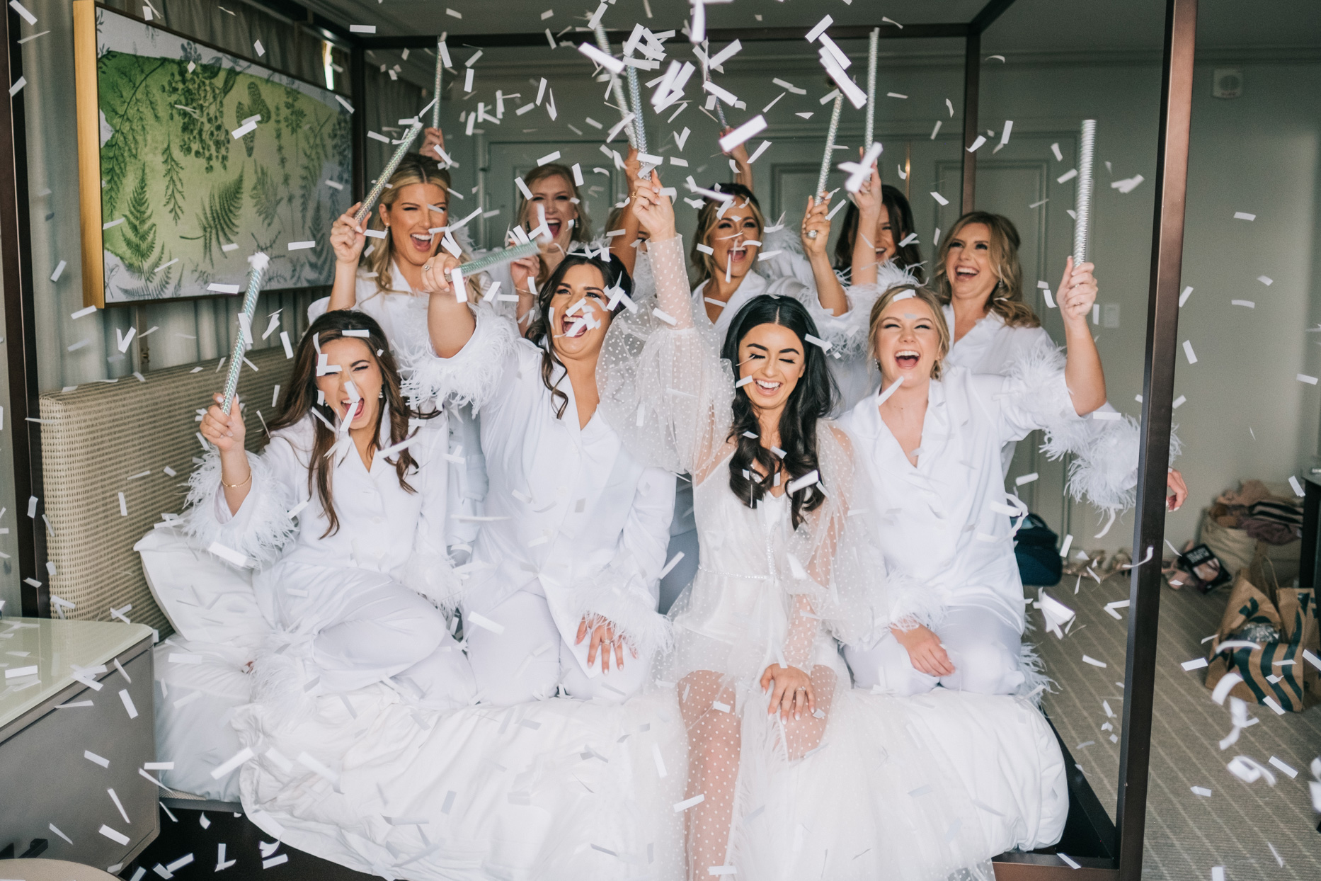 bride and bridal party popping confetti