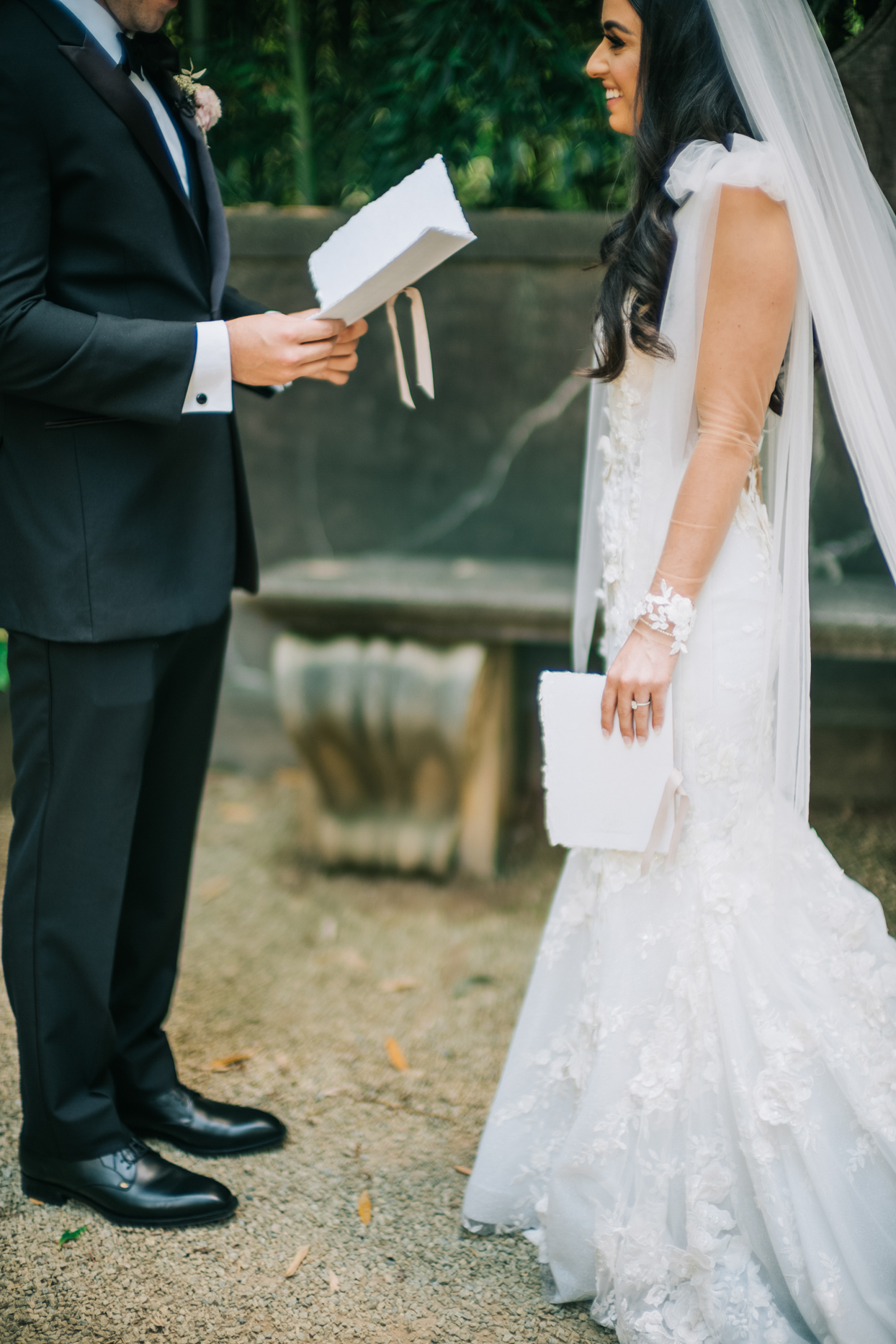 bride and groom privately exchanging vows