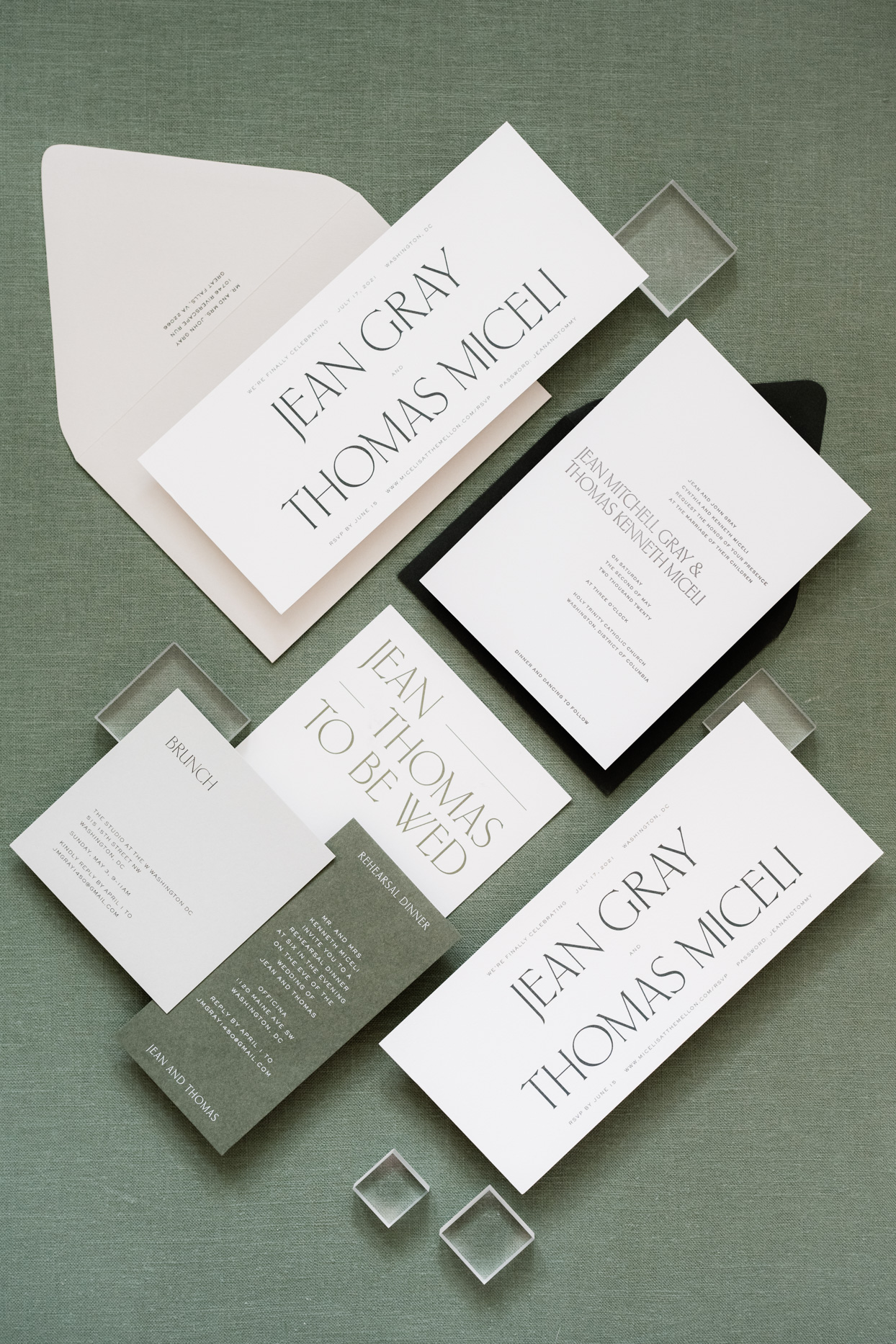 wedding invitation suite with green accents