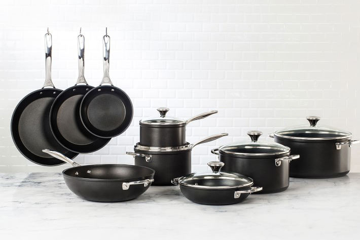 le creuset nonstick pro pans and pots on counter