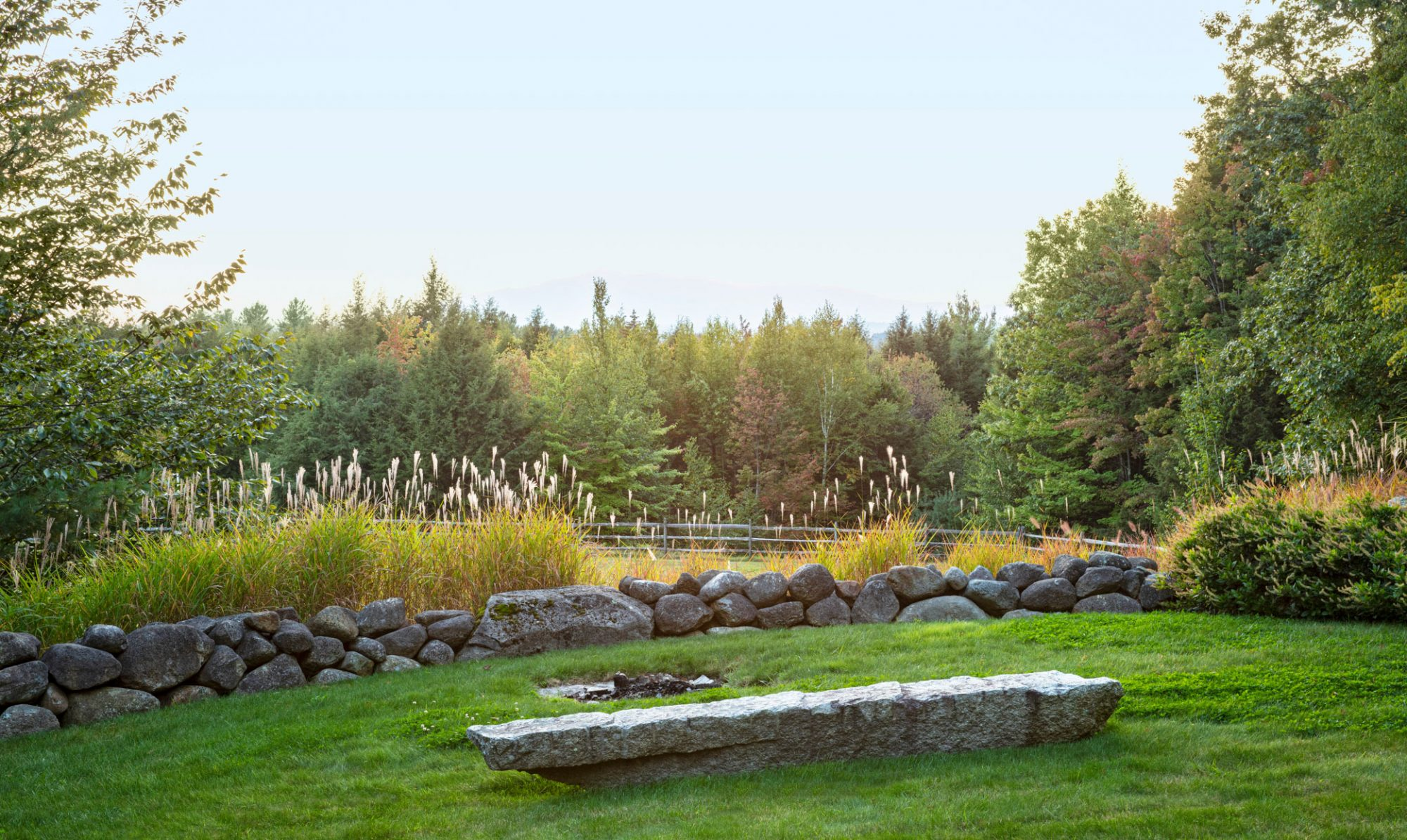 natural stone fire pit in meadow