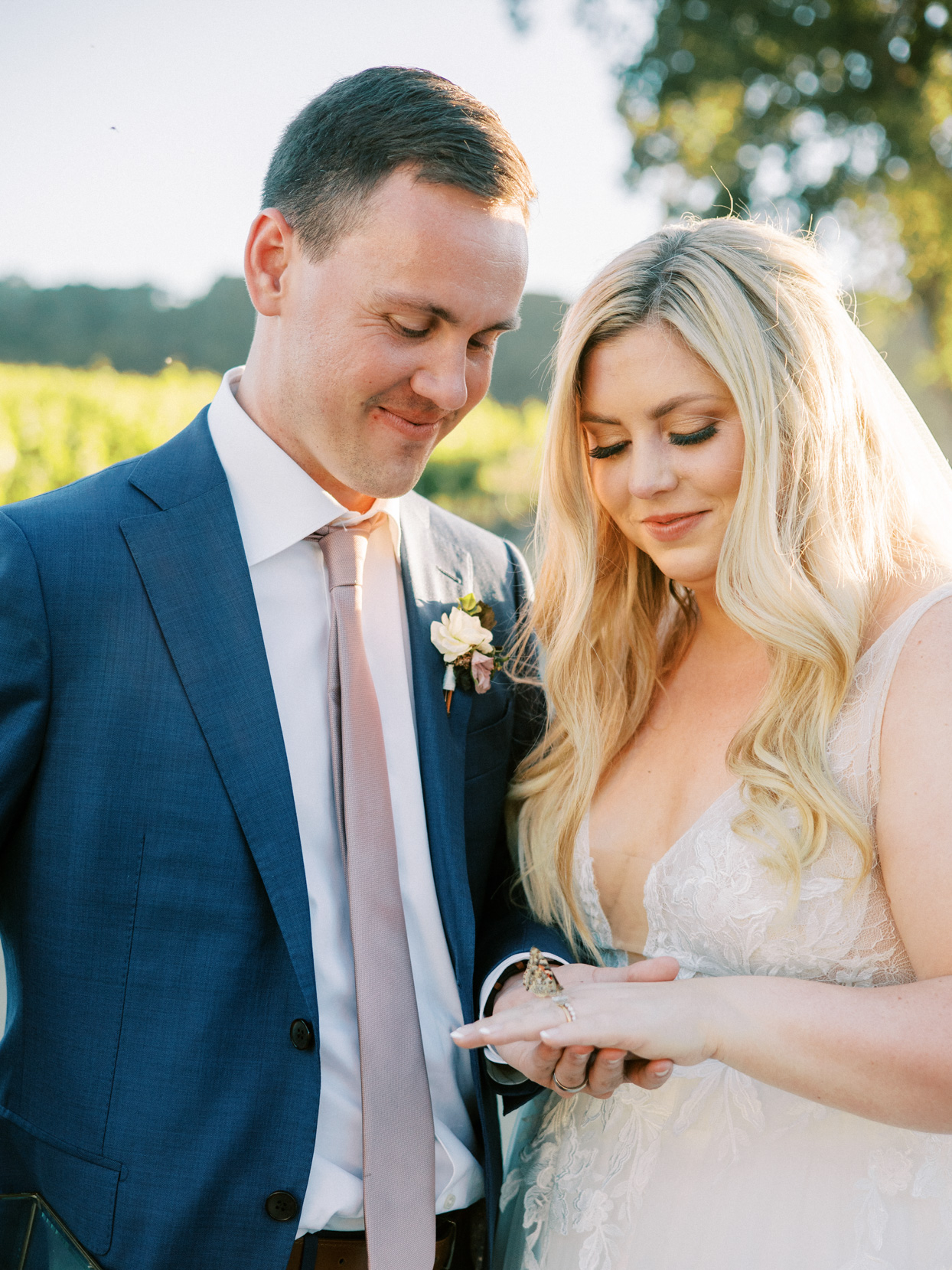 couple portrait with butterfly on bride's hand