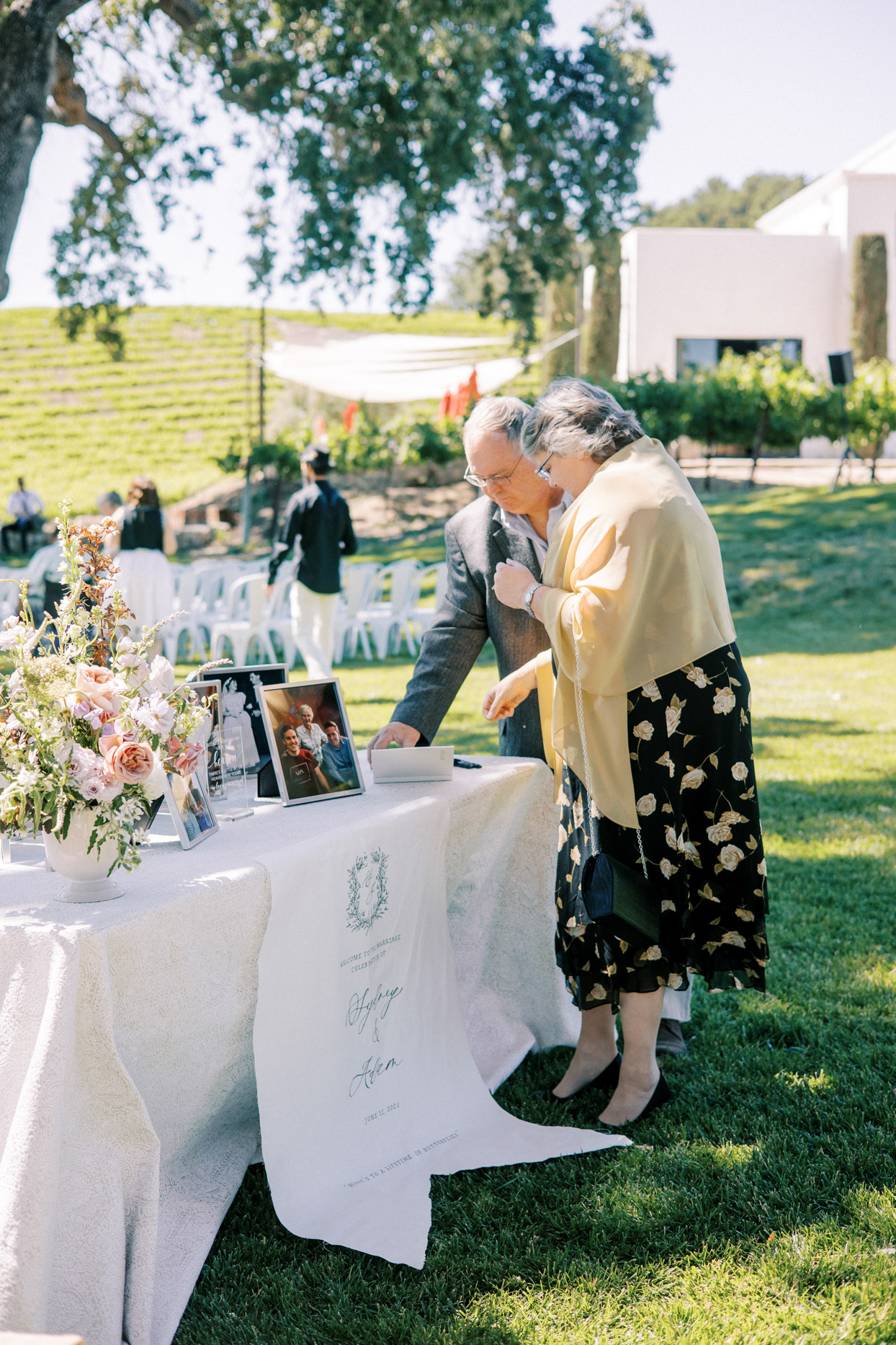 older couple standing at wedding generations table
