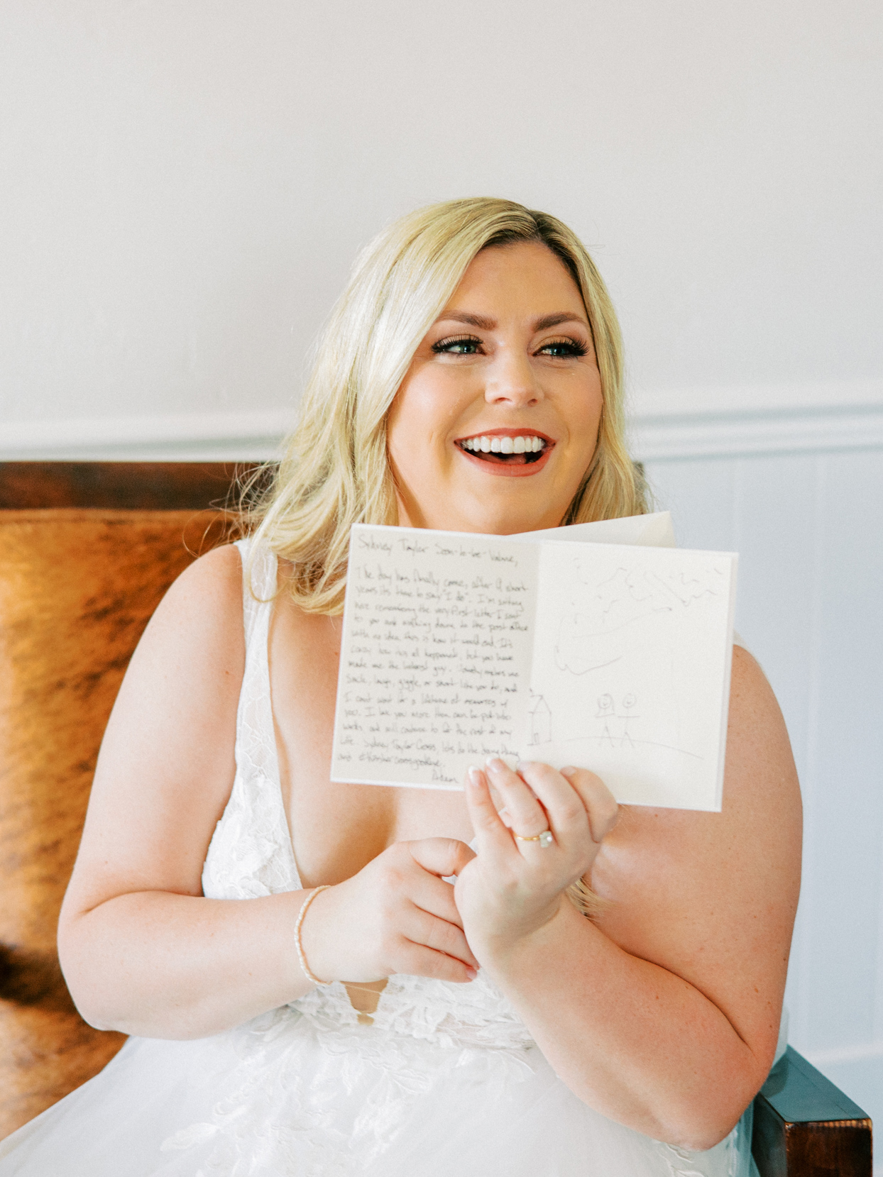 bride smiling and holding wedding notes