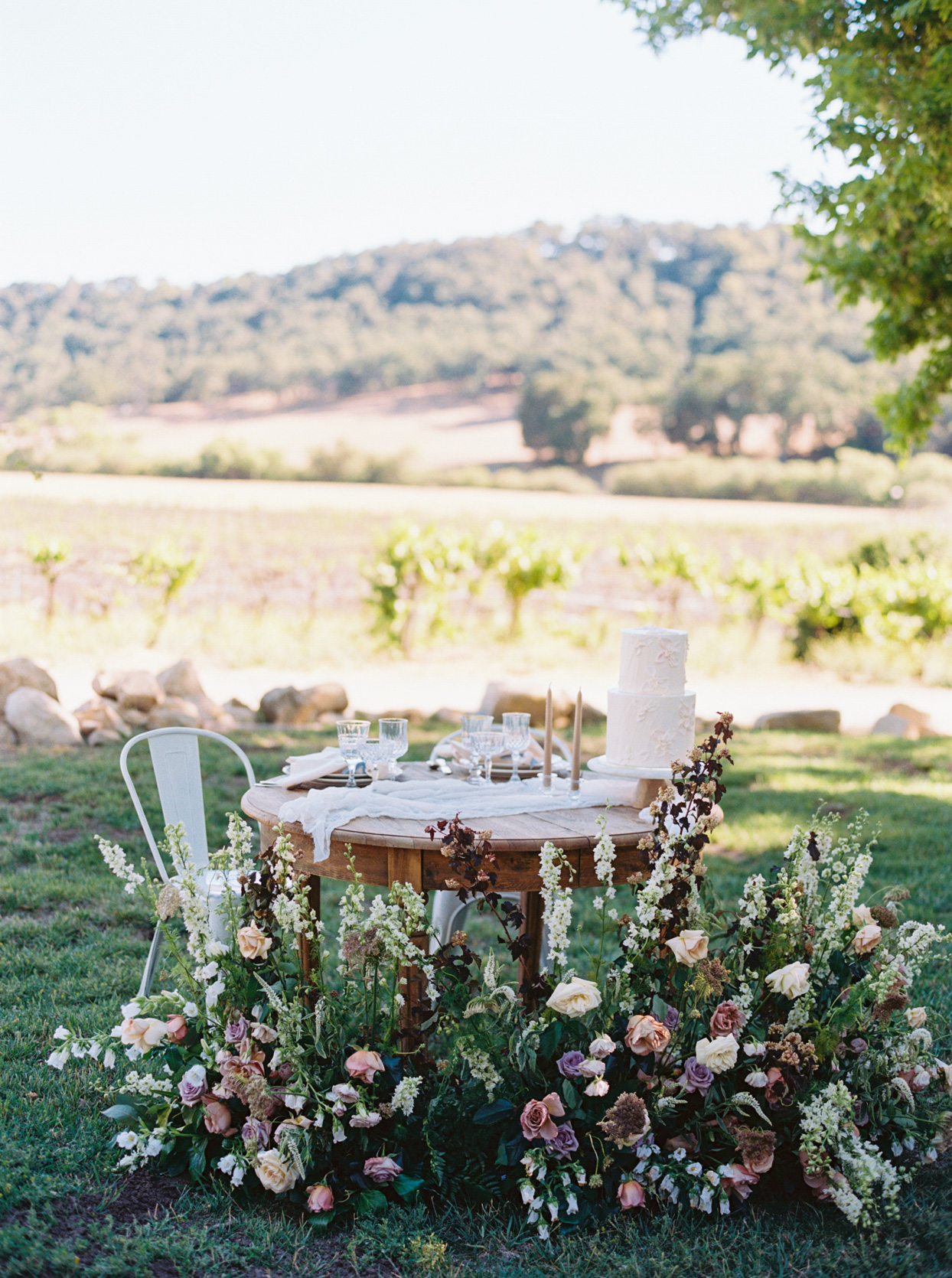 rustic wooden sweetheart table at outdoor wedding