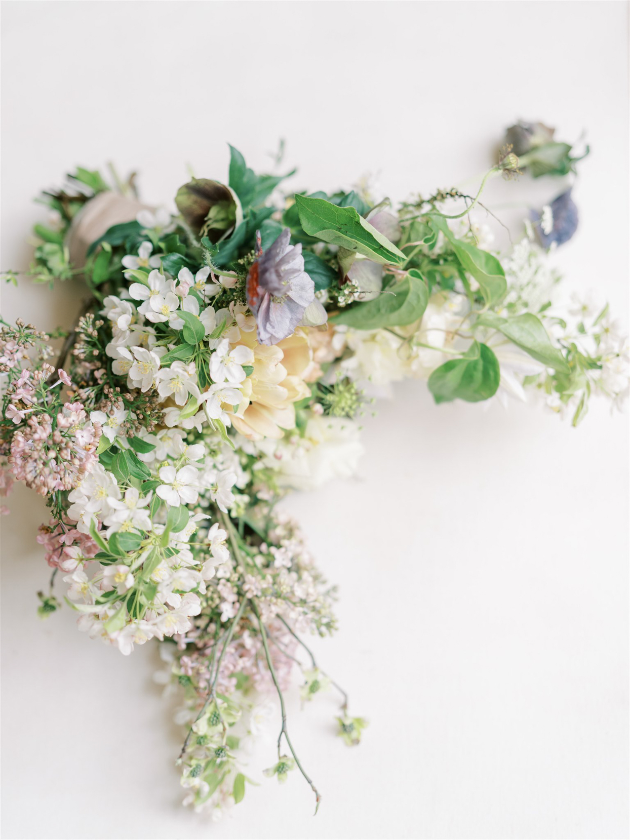 loose bridal bouquet of lilacs garden roses and crabapple branches