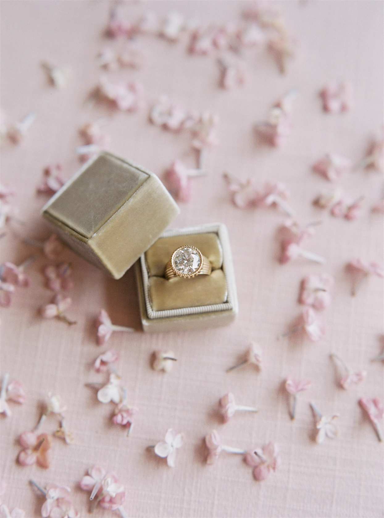 round engagement ring with gold band