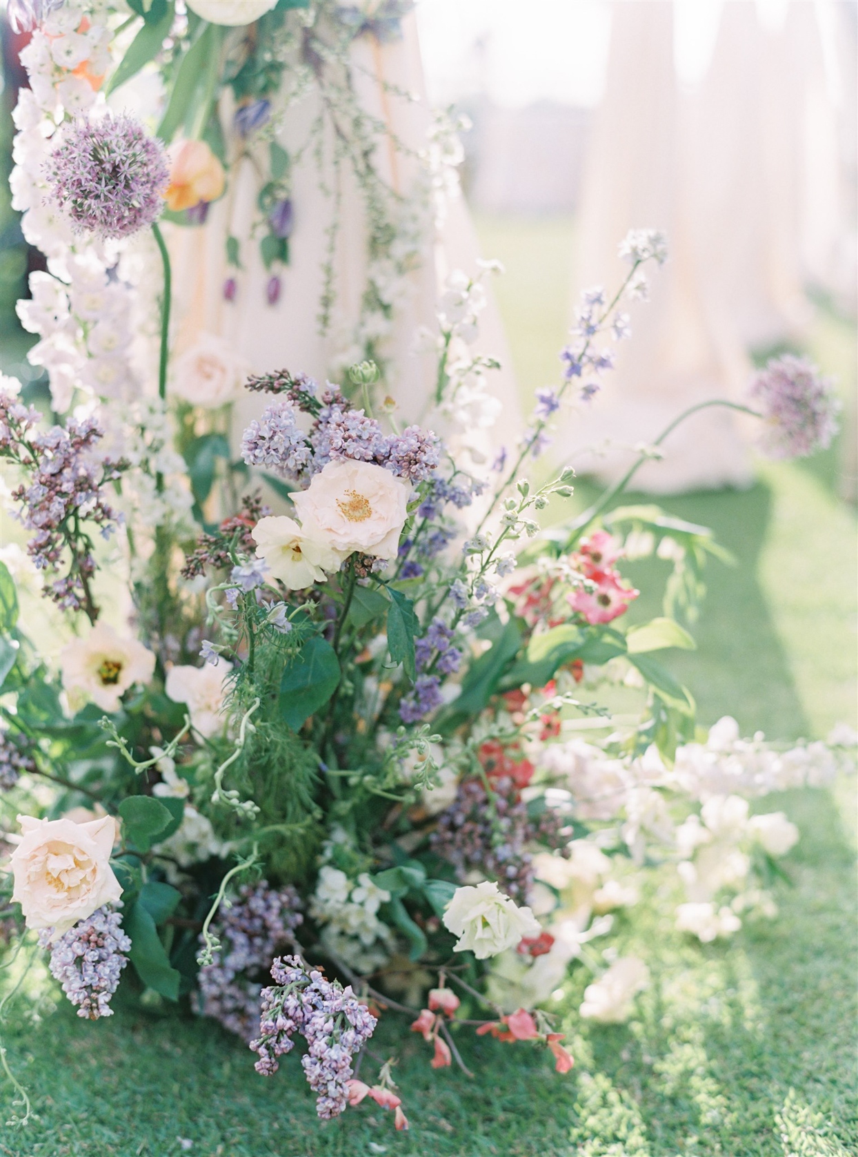 lush wedding reception florals with lilacs