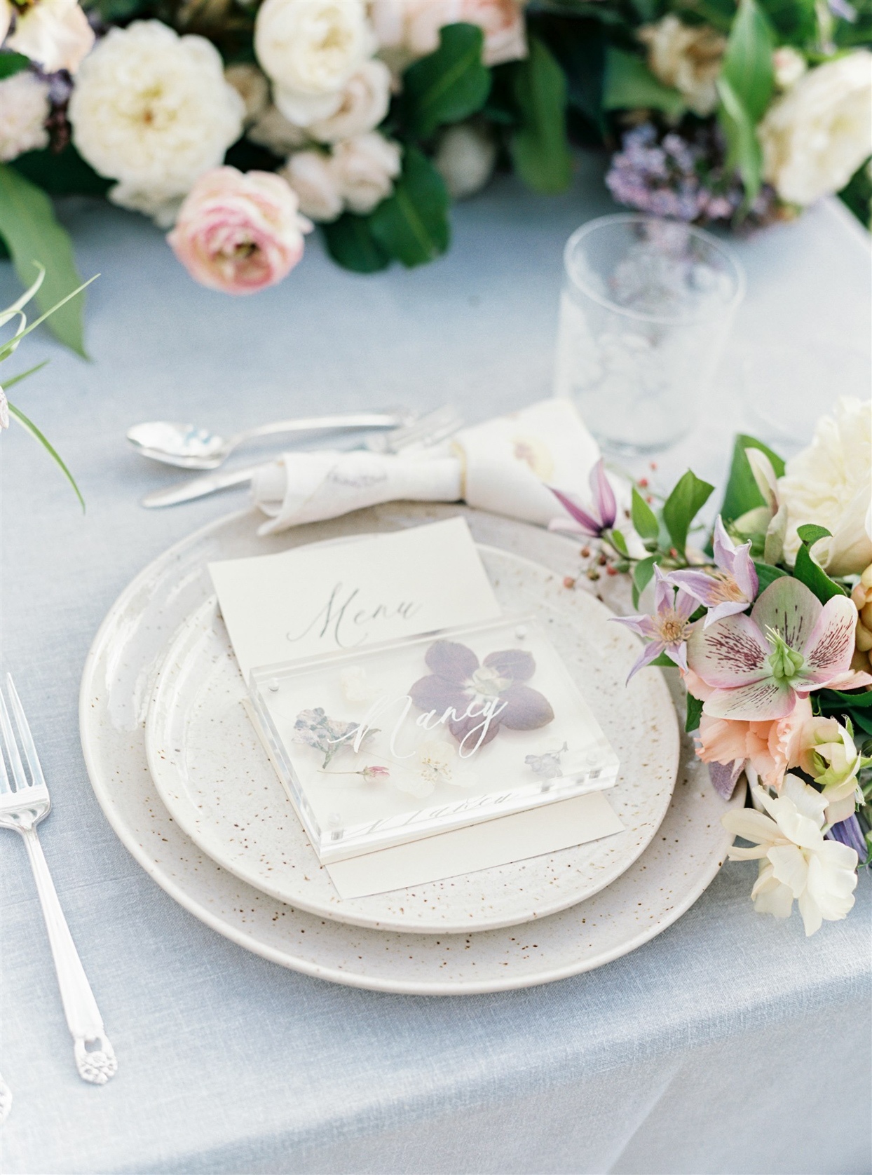 wedding reception place setting with engraved blocks with dried flowers as place cards