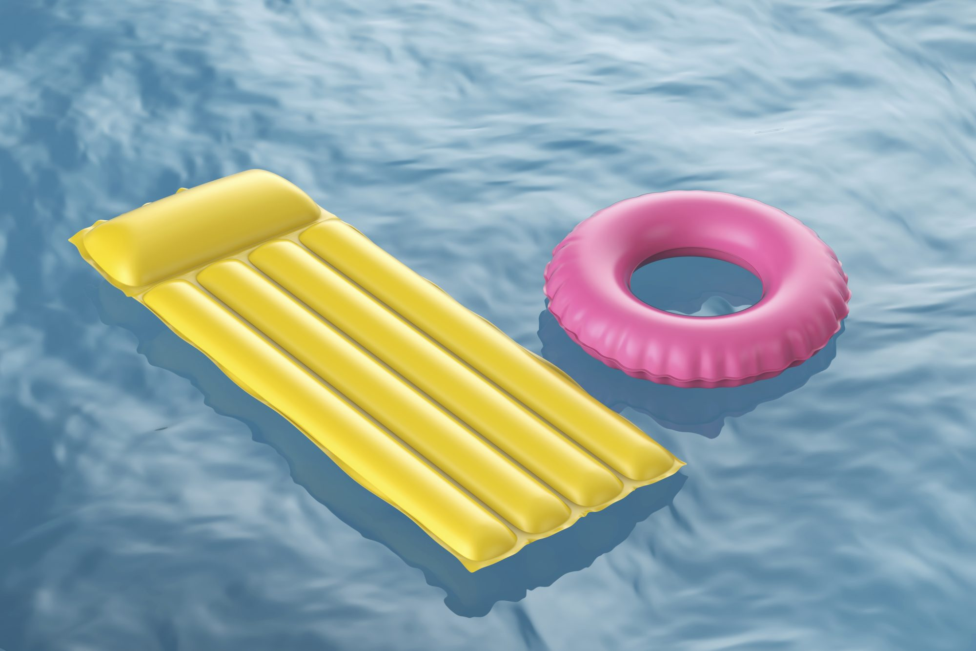 yellow and pink inflatable pool raft in pool