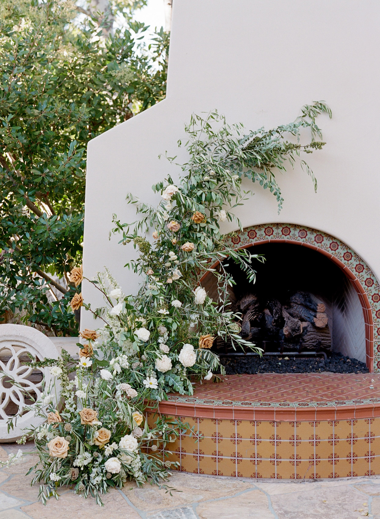 greenery and floral fireplace decor outside