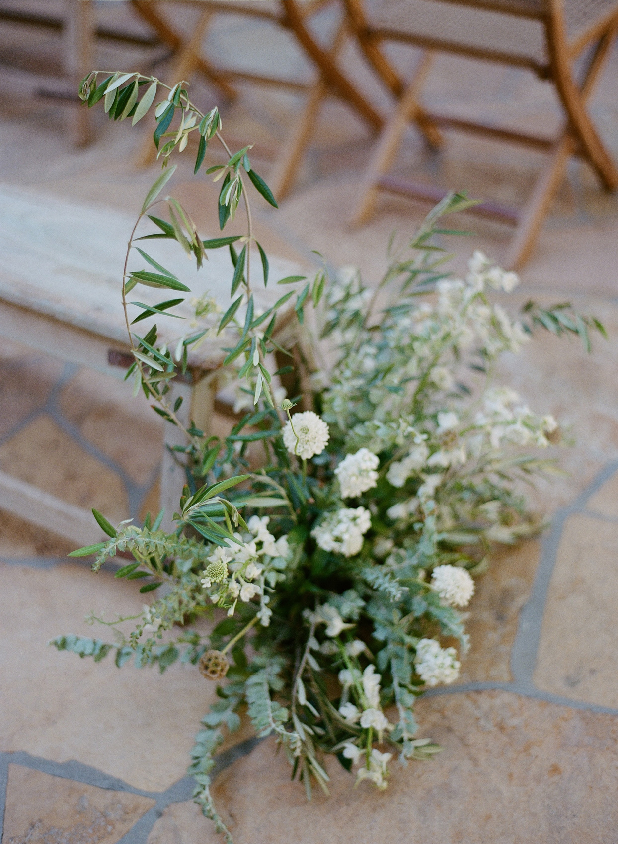 white floral and greenery ceremony decor