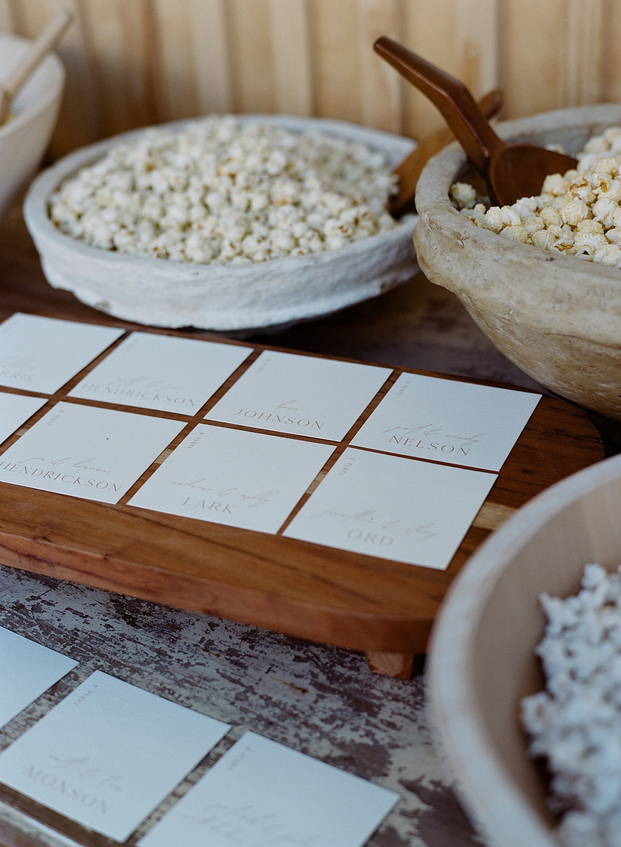 escort cards surrounded by popcorn filled bowls