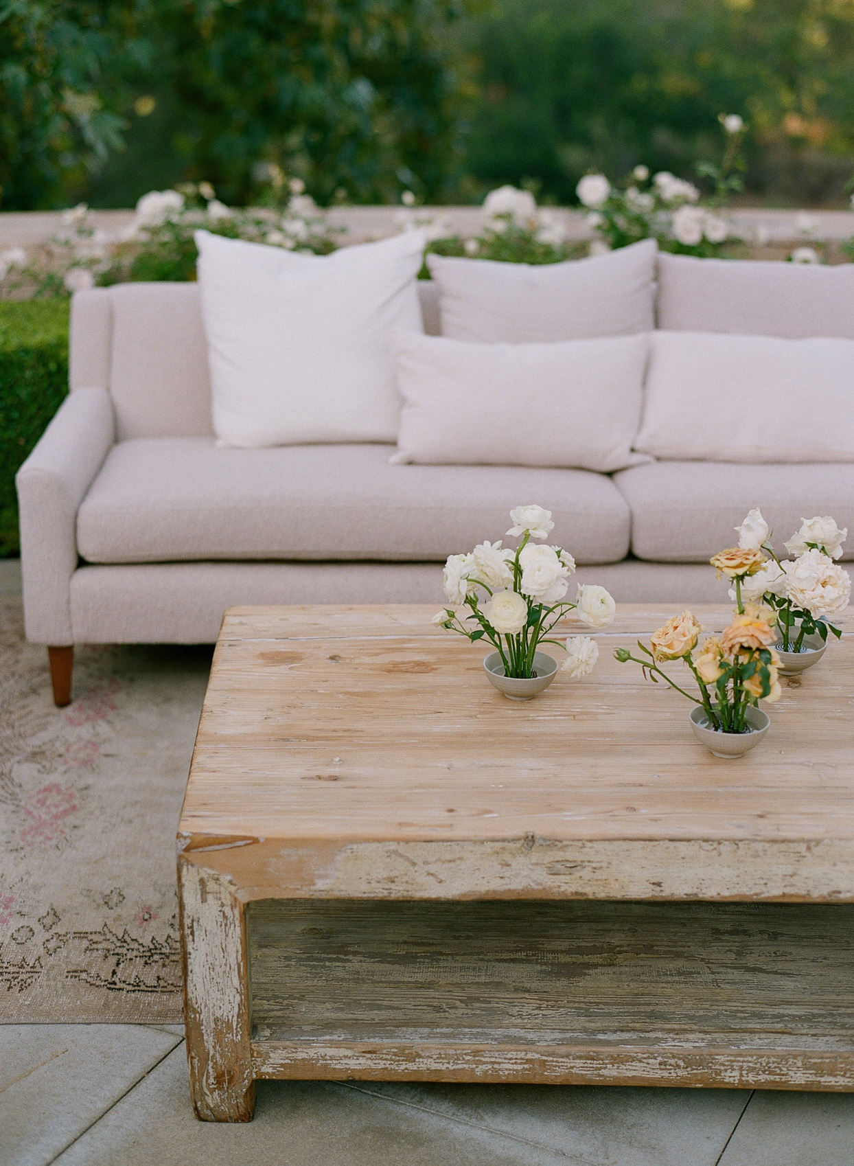 tan couch wedding lounge area