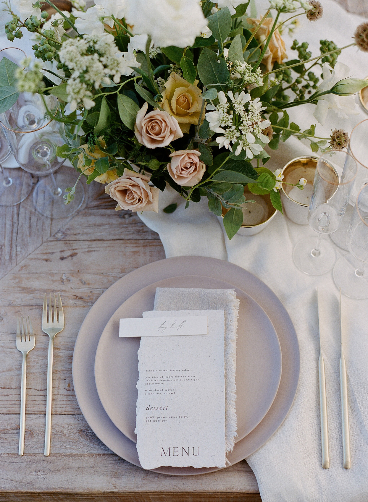 neutral hued wedding reception place settings